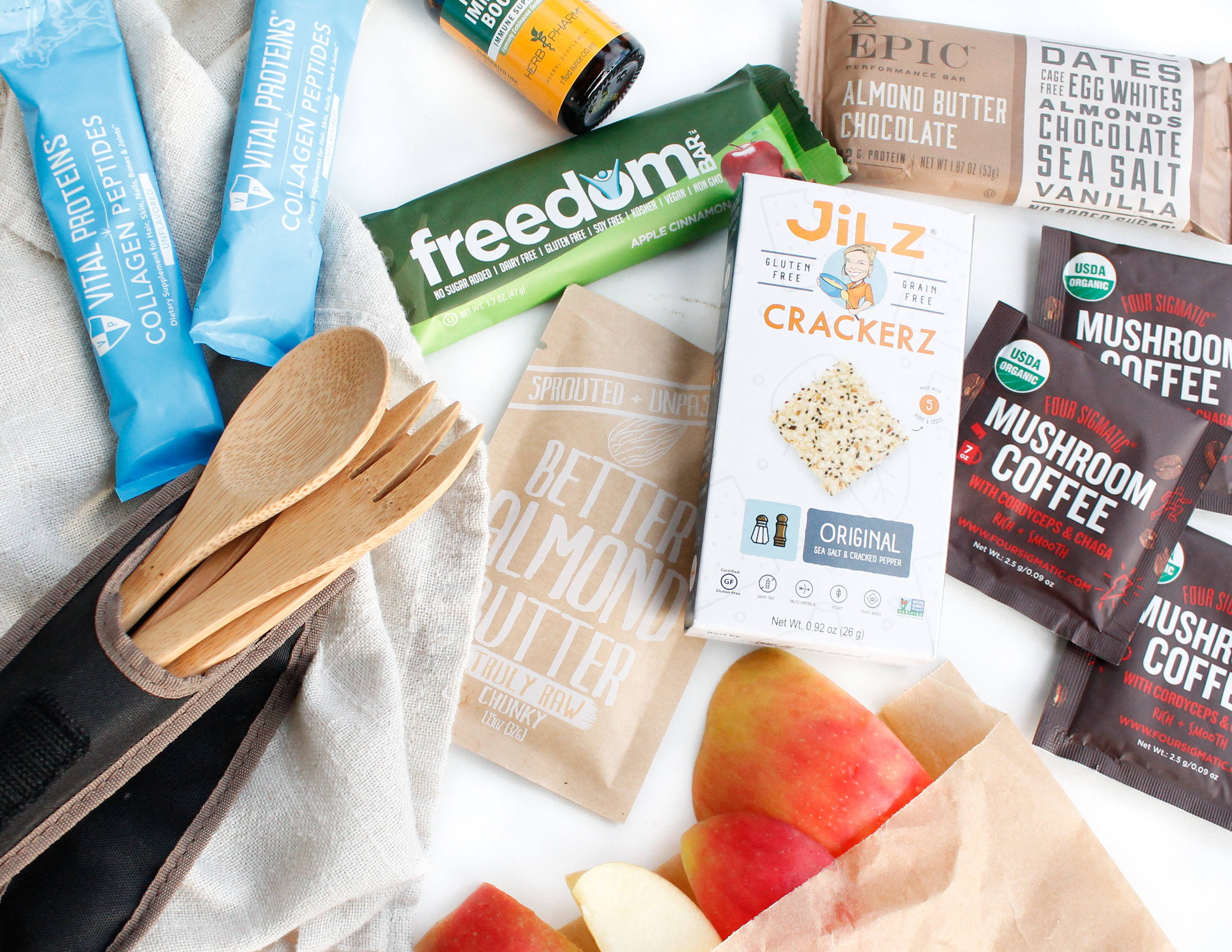 (please note that this blog post is not sponsored by any of the pictured brands. I am simply showing some of my own favorite gut-friendly travel snacks and must-haves)