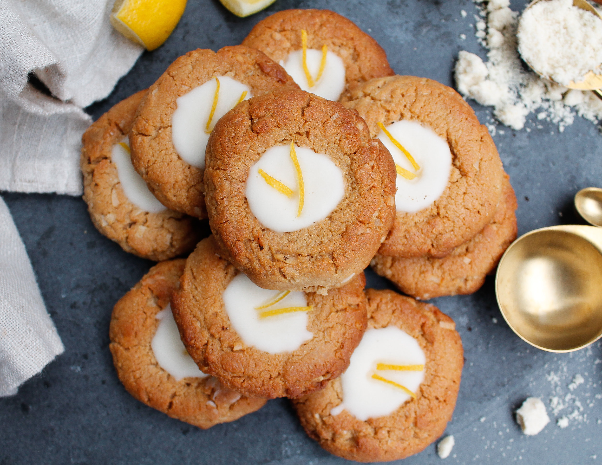 Paleo + Vegan Lemon Coconut Cookies || These paleo lemon coconut cookies satisfy your sweet tooth AND nourish your body! They're grain free, gluten free, dairy free, vegan, refined sugar free AND Specific Carbohydrate Diet friendly! They're rich, yet refreshing with the delicious lemon flavor and creamy coconut butter thumbprint filling. The perfect healthy summer snack or healthy summer sweet treat! || #scddiet #specificcarbohydratediet #paleocookiedough