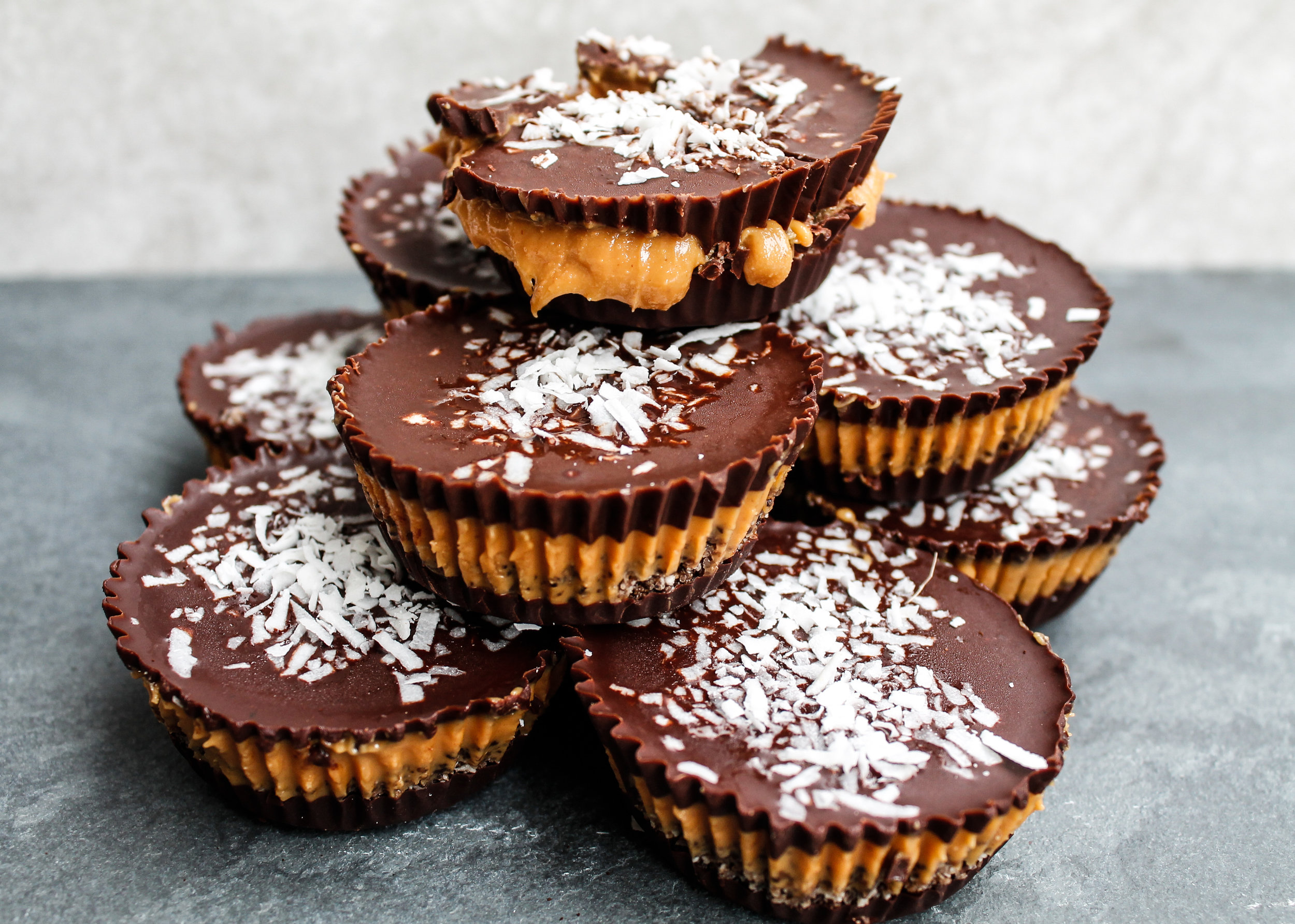These Coconut Coffee Nut Butter Cups are the perfect healthy Valentine's Day treat to show yourself and your loved ones how much you care! They're paleo, dairy free, gluten free AND refined sugar free, making them a perfect healthy alternative for dessert or a midday sweet treat. A quick and healthy dessert recipe to satisfy your sweet tooth! #healthydessert #vegan