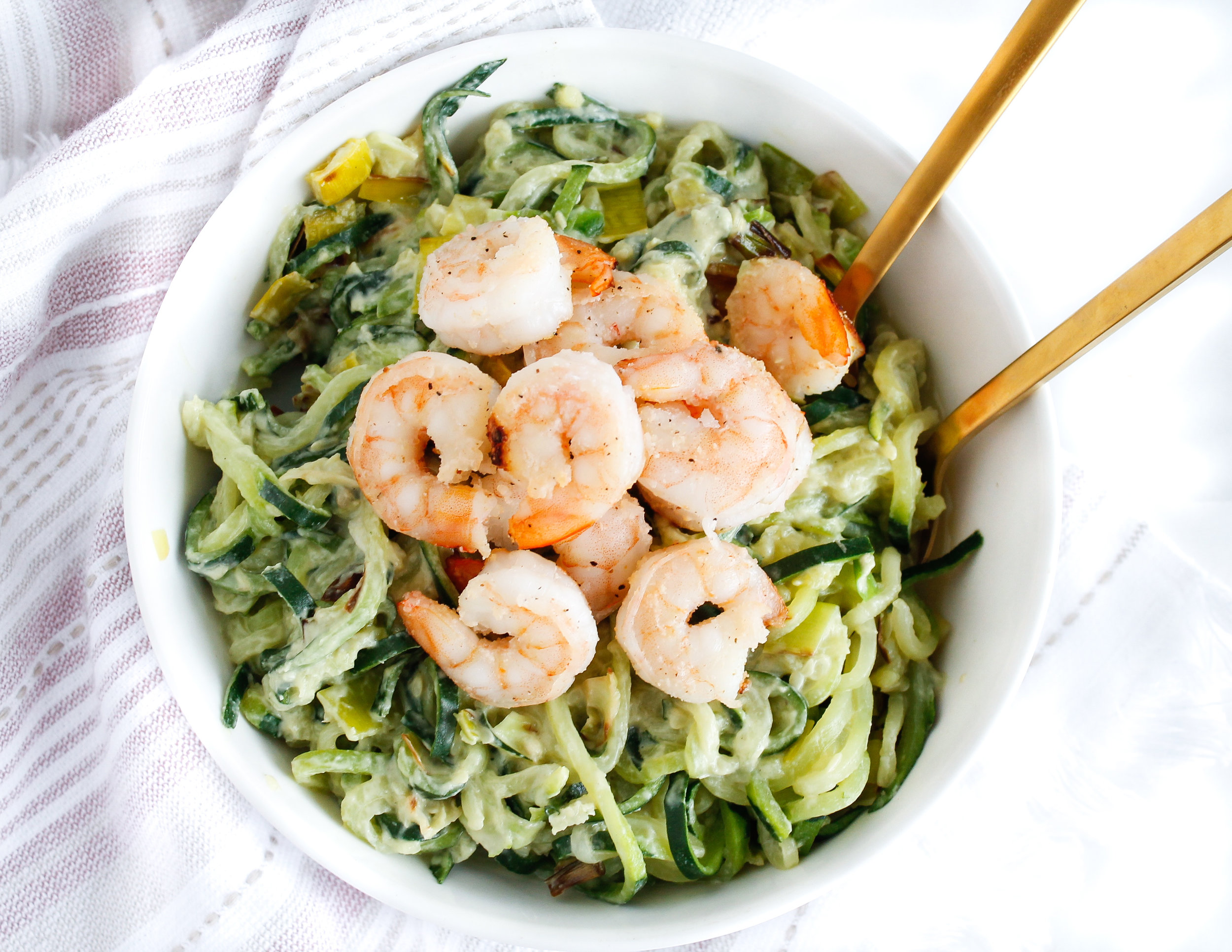 Creamy tahini avocado zoodles with shrimp makes for the perfect paleo approved lunch or dinner! Full of protein, healthy fats and TONS of flavor. It's grain free, gluten free, dairy free and Specific Carbohydrate Diet friendly! #paleodinner #paleorecipes #specificcarbohydratediet