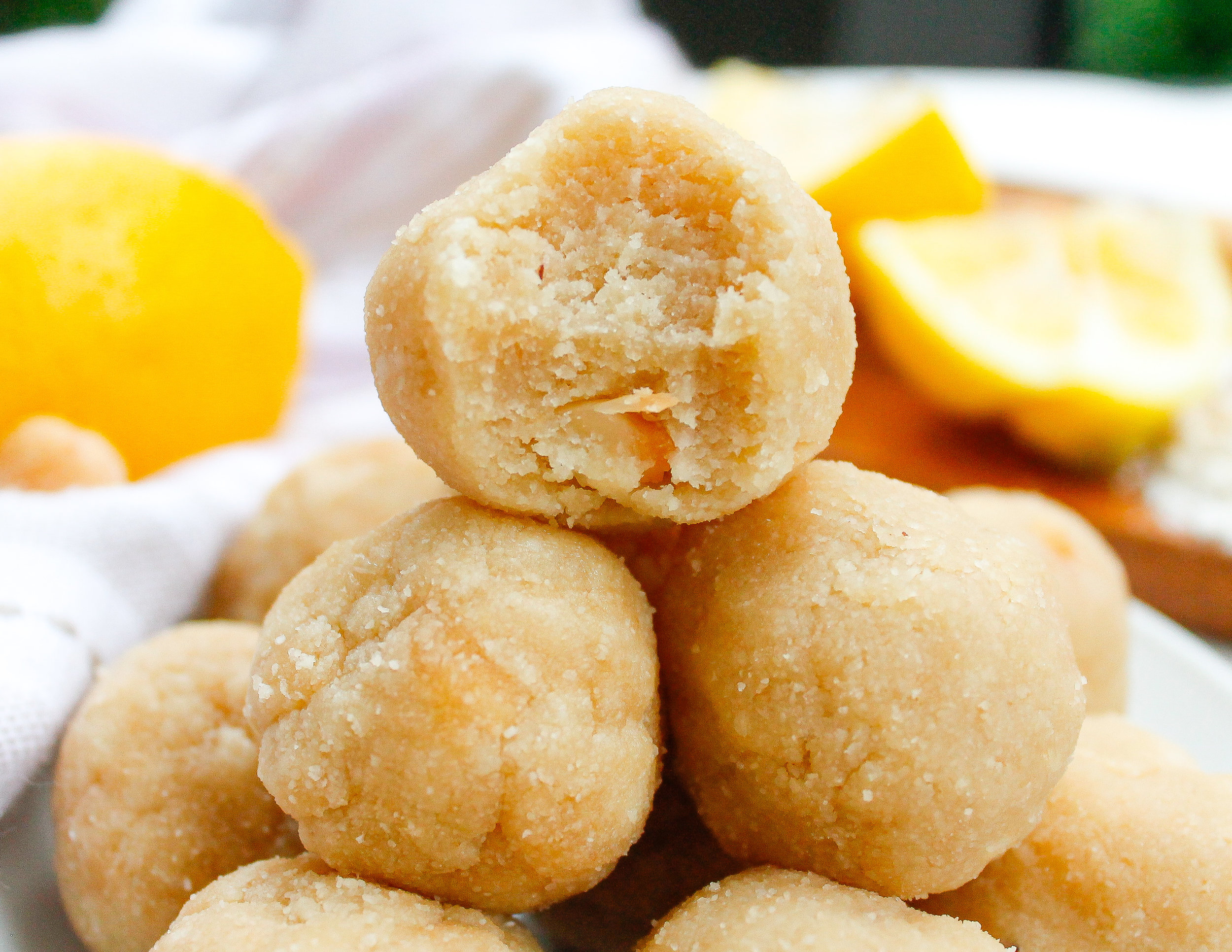 Paleo Lemon Cookie Dough Bites || These paleo cookie dough balls are decadent yet oh-so-healthy! They're grain free, gluten free, dairy free, refined sugar free AND Specific Carbohydrate Diet friendly! They're rich, yet refreshing with the delicious lemon flavor and bites of crunchy macadamia nuts. The perfect healthy summer snack or healthy summer sweet treat! || #scddiet #specificcarbohydratediet #paleocookiedough