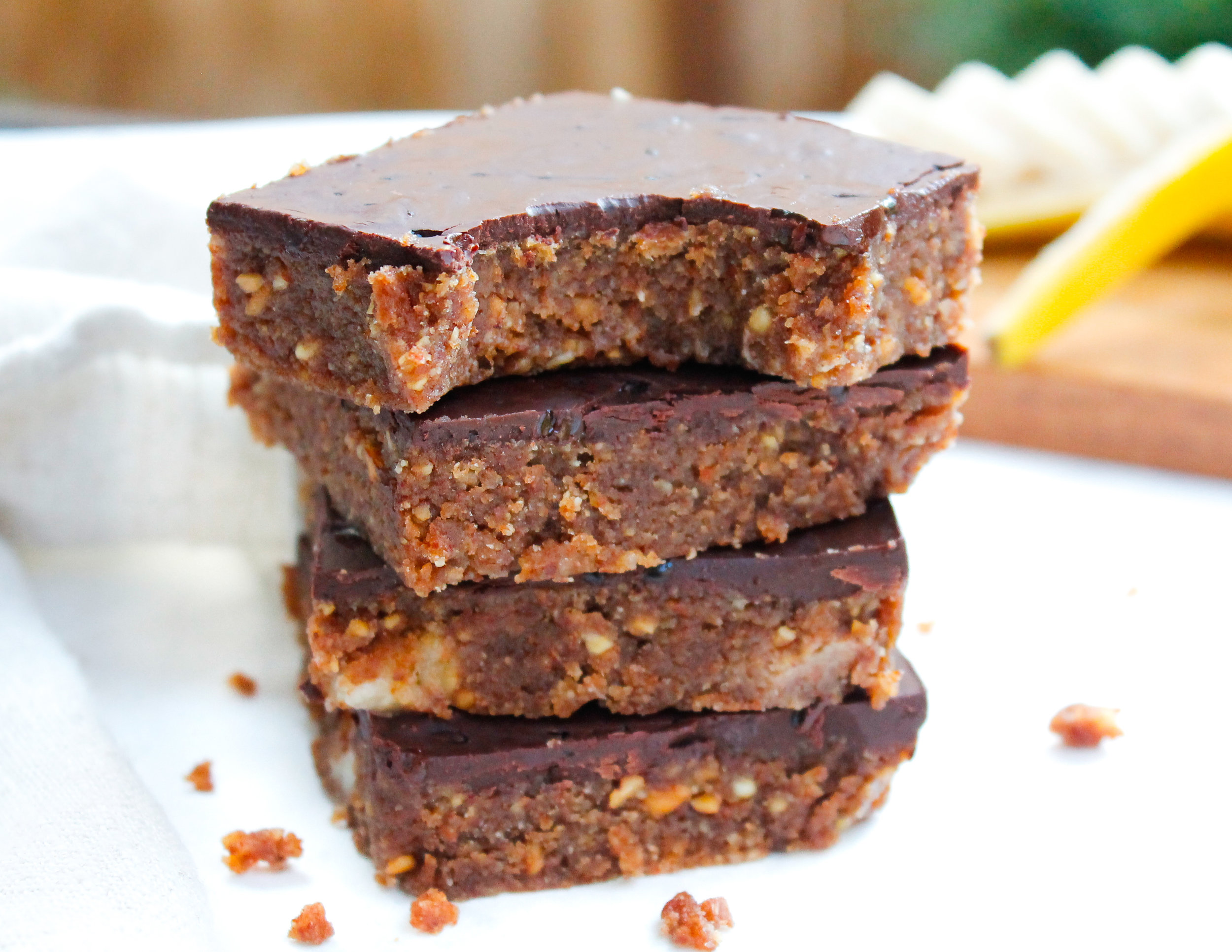 Paleo + Vegan Banana Bread No-Bake Bars || These bars are gluten free, grain free, dairy free, refined sugar free AND easily made Specific Carbohydrate Diet friendly by omitting the chocolate topping. These paleo no bake bars are easy and delicious! The perfect on-the-go and healthy kid-friendly creation you can whip up in less than 30 minutes. #paleobars #paleosnackrecipes #paleosweettreats