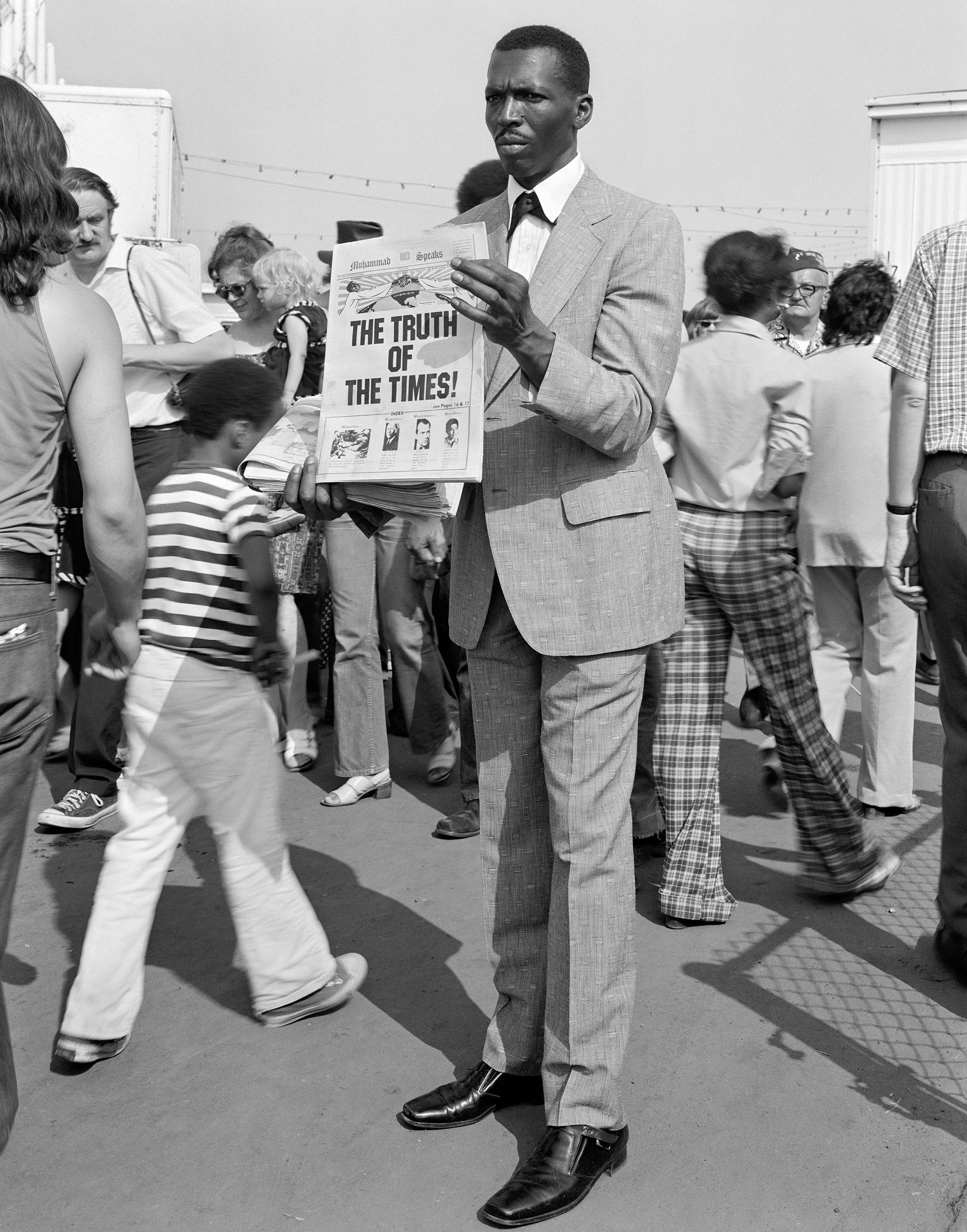 Man Handing Out Muslim Newspaper, Detroit, Michigan, 1973