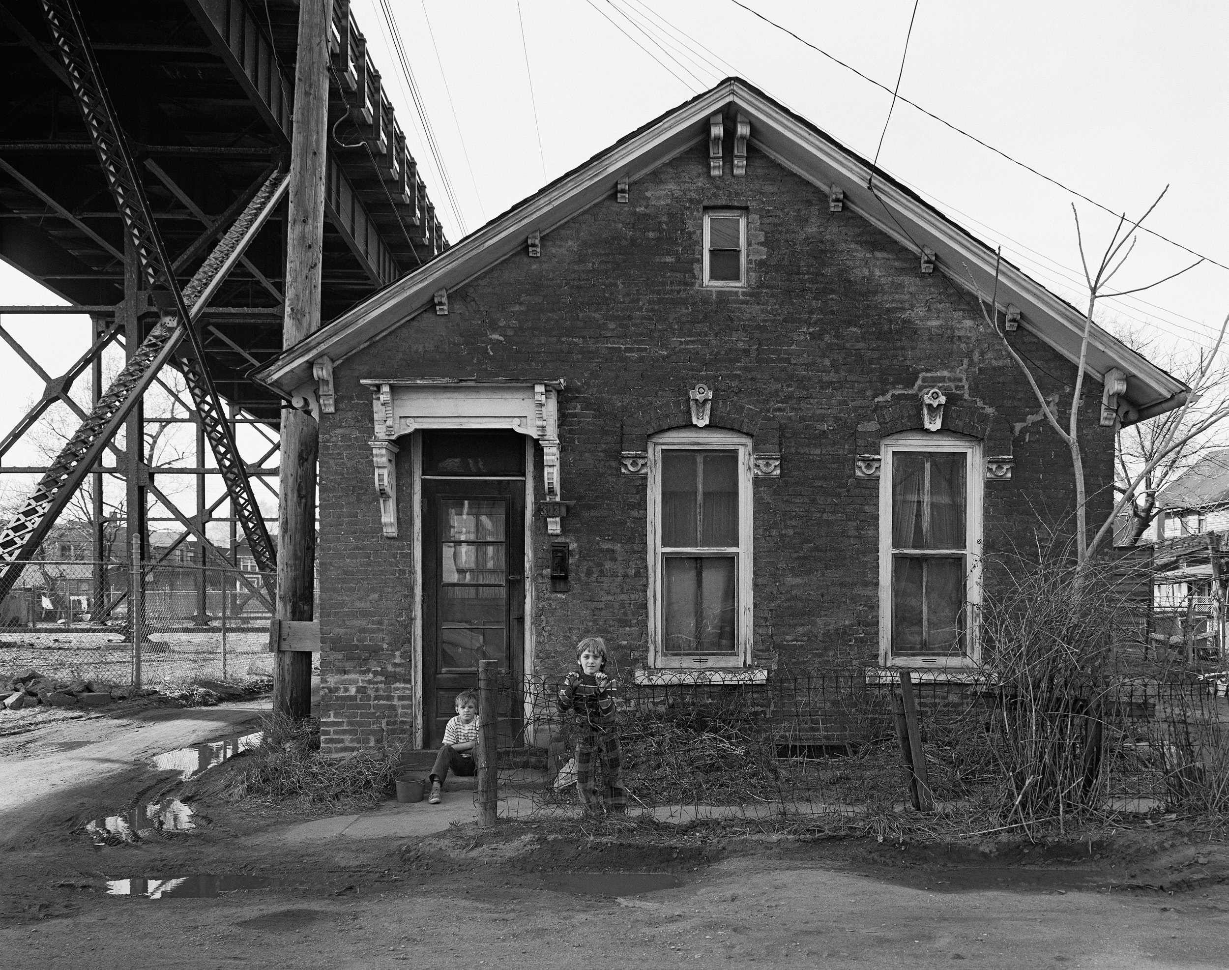 Two Boys in Front of House Under the Ambassador Bridge, Detroit, Michigan, 1974