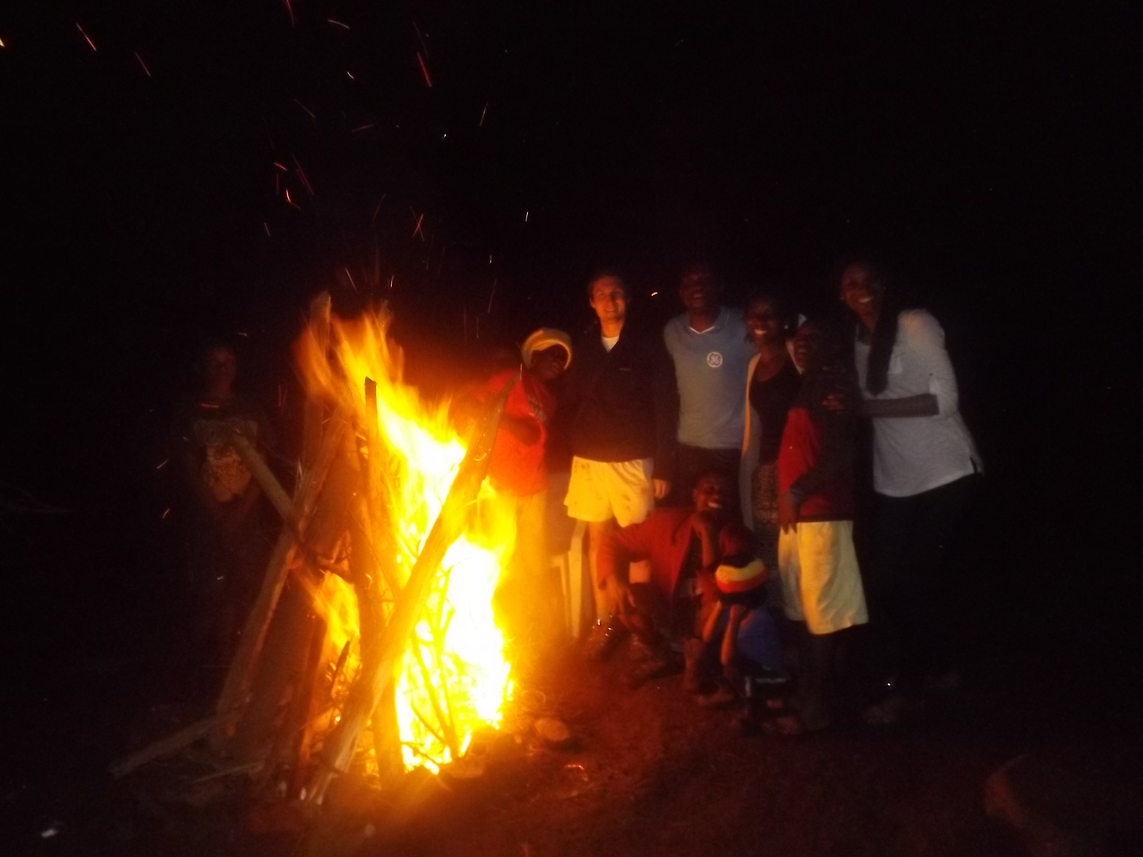 A little hard to see, but the GE volunteers with some of the children during the bonfire.