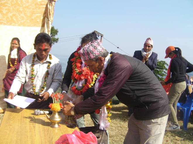 DSB board Pair Nanda Raj Pandey lights the incense for the ceremony.