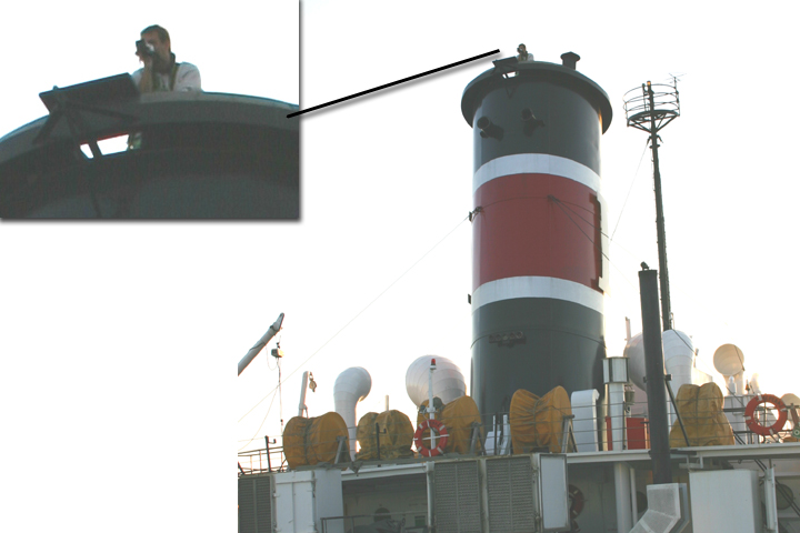 Filming atop a smokestack on a freighter