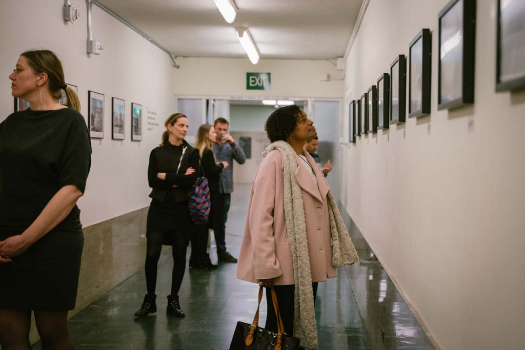 Susan Brown, Director of Special Projects at the Willie Brown Institute, checks out the Visions of Justice exhibition during the opening night.