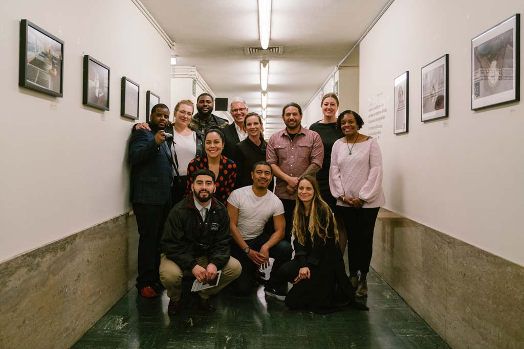 "Group photo of workshop students, CatchLight staff, photographer Brian L. Frank, Susan Brown and District Attorney George Gascón in the hallway that is home to ""Visions of Justice"" on view through April 1, 2019."