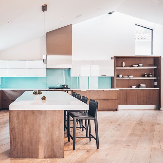 Sleek. Clean. Cutting-edge. This Los Altos Contemporary Kitchen is eye-catching, elevated, and evolved. The cerulean, high gloss backsplash brings a subtle, but significant, pop of color to this modernist marvel of a kitchen. ⚡️⁠ ⁠ Optmira Client Spotlight: Signature Kitchen & Bath Design is a Cupertino-based cabinetry company that crafts custom living spaces for their clients. With a desire to refine their brand identity, Optmira implemented a variety of content marketing strategies to achieve this goal.⁠ ⁠ #backsplash #losaltos #kitchenremodel #lovelysquares #dreamkitchen #sanjosedesign #sanjoseremodel #kitchendesigner #SIGKB #signaturekitchen⁠ ⁠