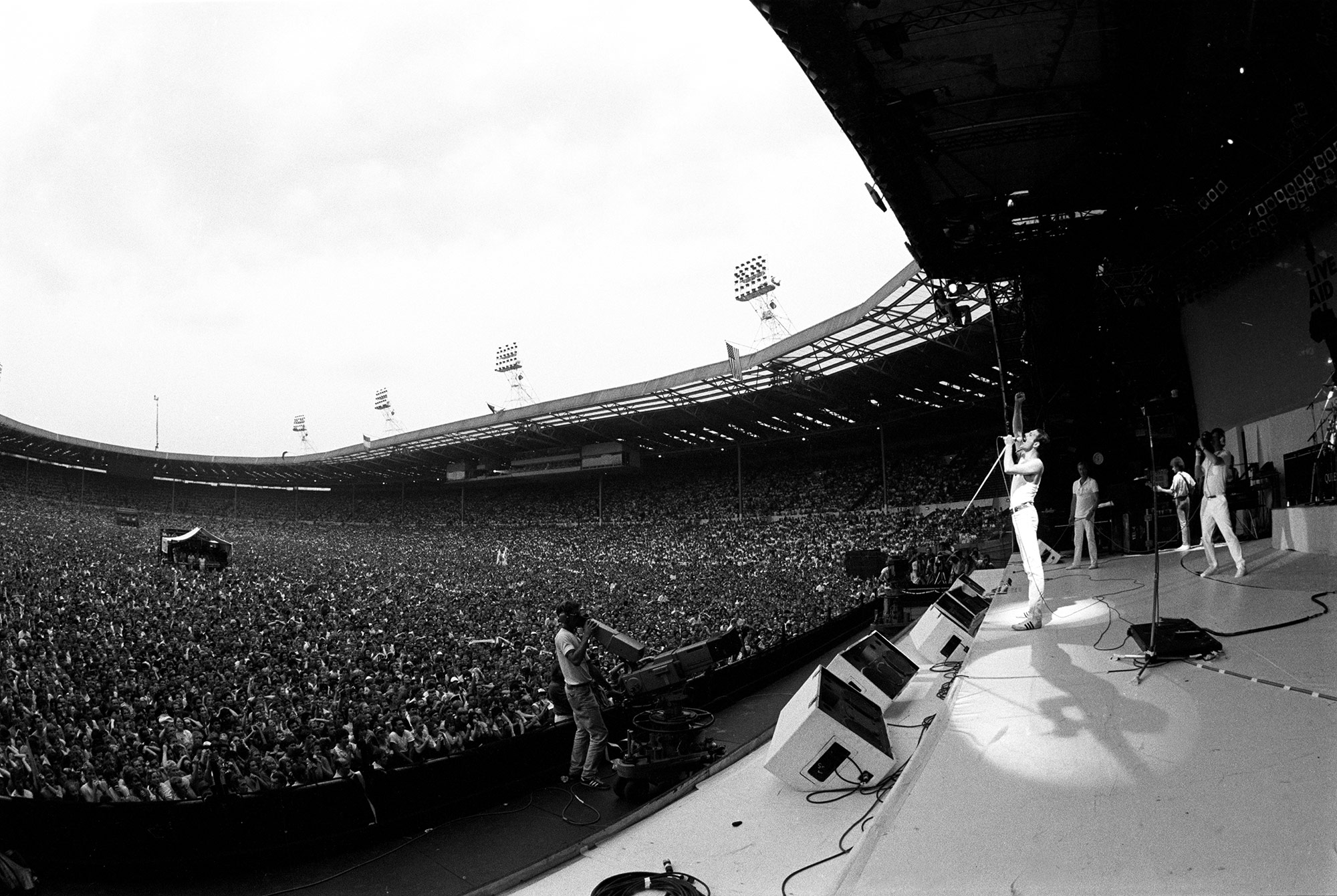 Freddie.  Photo Credits: Queen performs at Live Aid in London in 1985.  (Neal Preston)    from:   https://www.cnn.com/interactive/2018/11/opinions/queen-live-aid-cnnphotos/