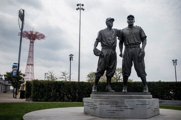 Pee Wee Reese & Jackie Robinson at the Entryway to MCU Park. Image: Andrew Burton, Getty Images North America from  zimbio.com/pictures/pHu2wOON_EL/Jackie+Robinson+Statue+Restored+Brooklyn