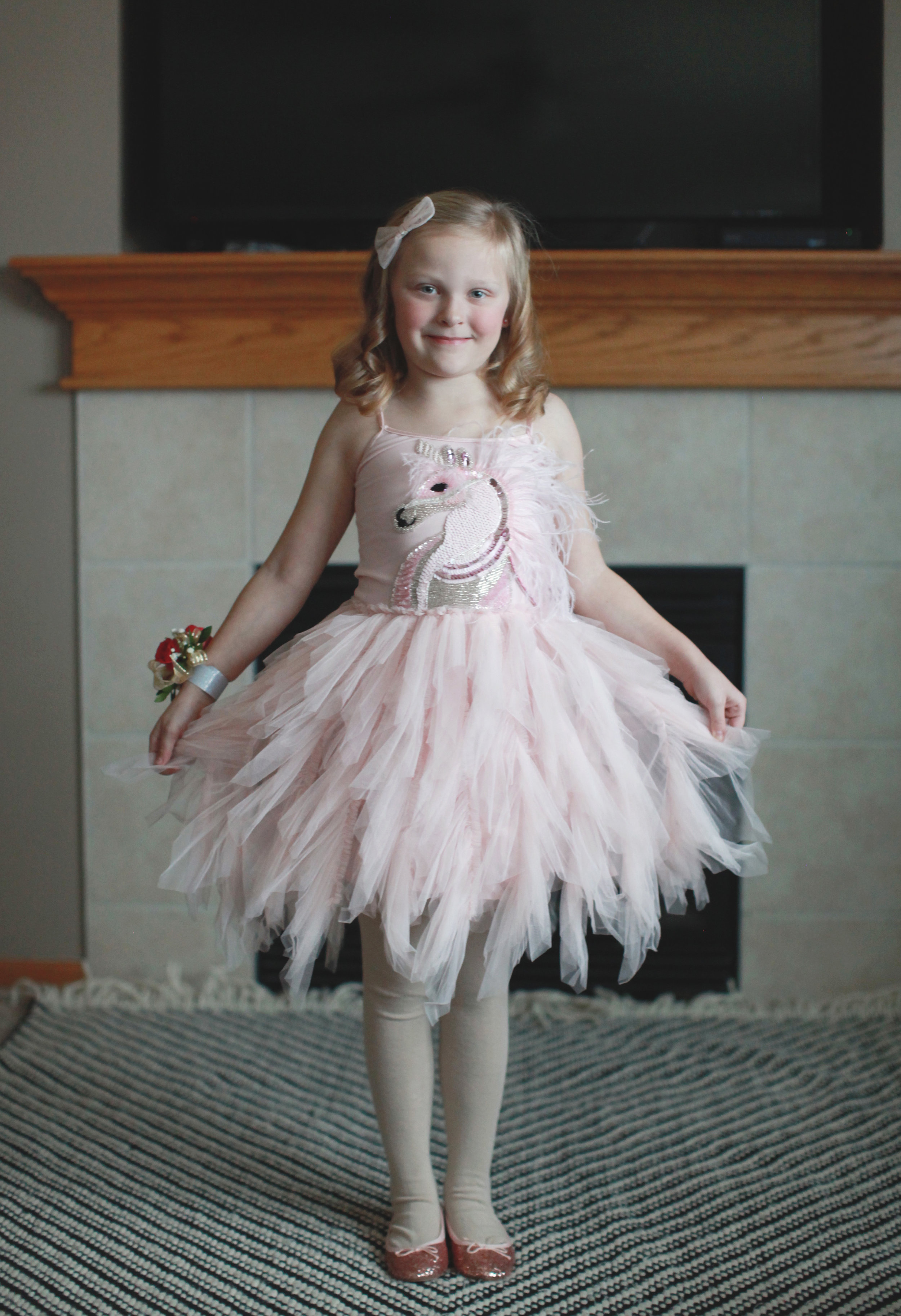 dress and bow from Rainey's Closet, shoes are Crewcuts and tights are Zara