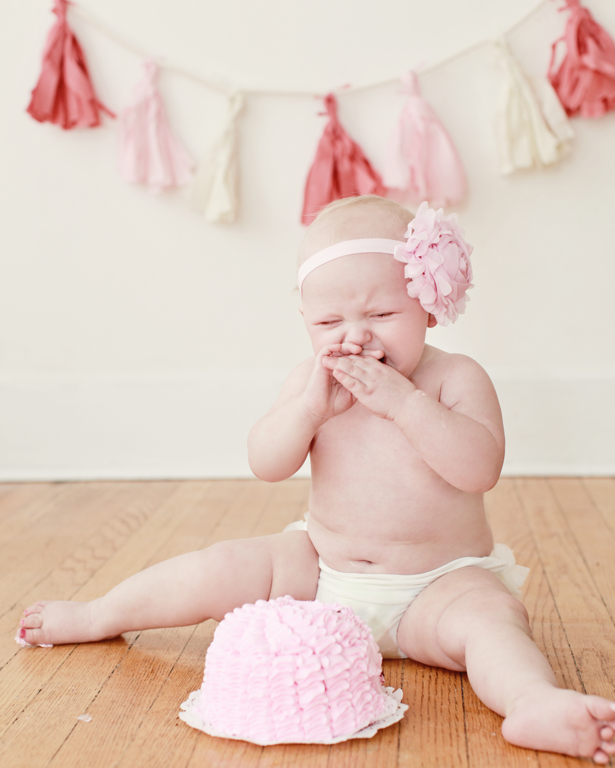 1st birthday photos go either way … no one was surprised these were how she felt about hers.