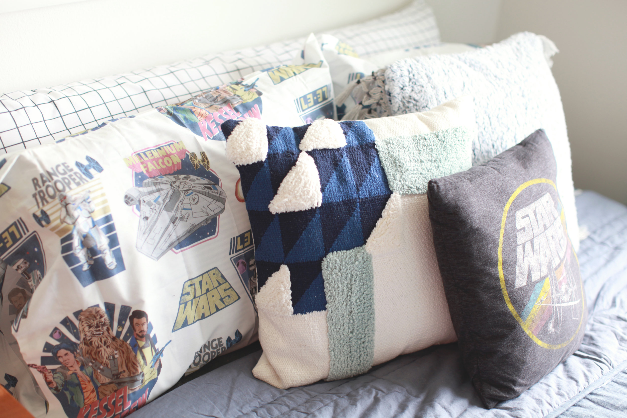 See - pillows are fun and amazing and I love the mix of patterns and shapes. Keeping the bedspread simple and classic and having these as pieces we can change out over time is more economical as well.