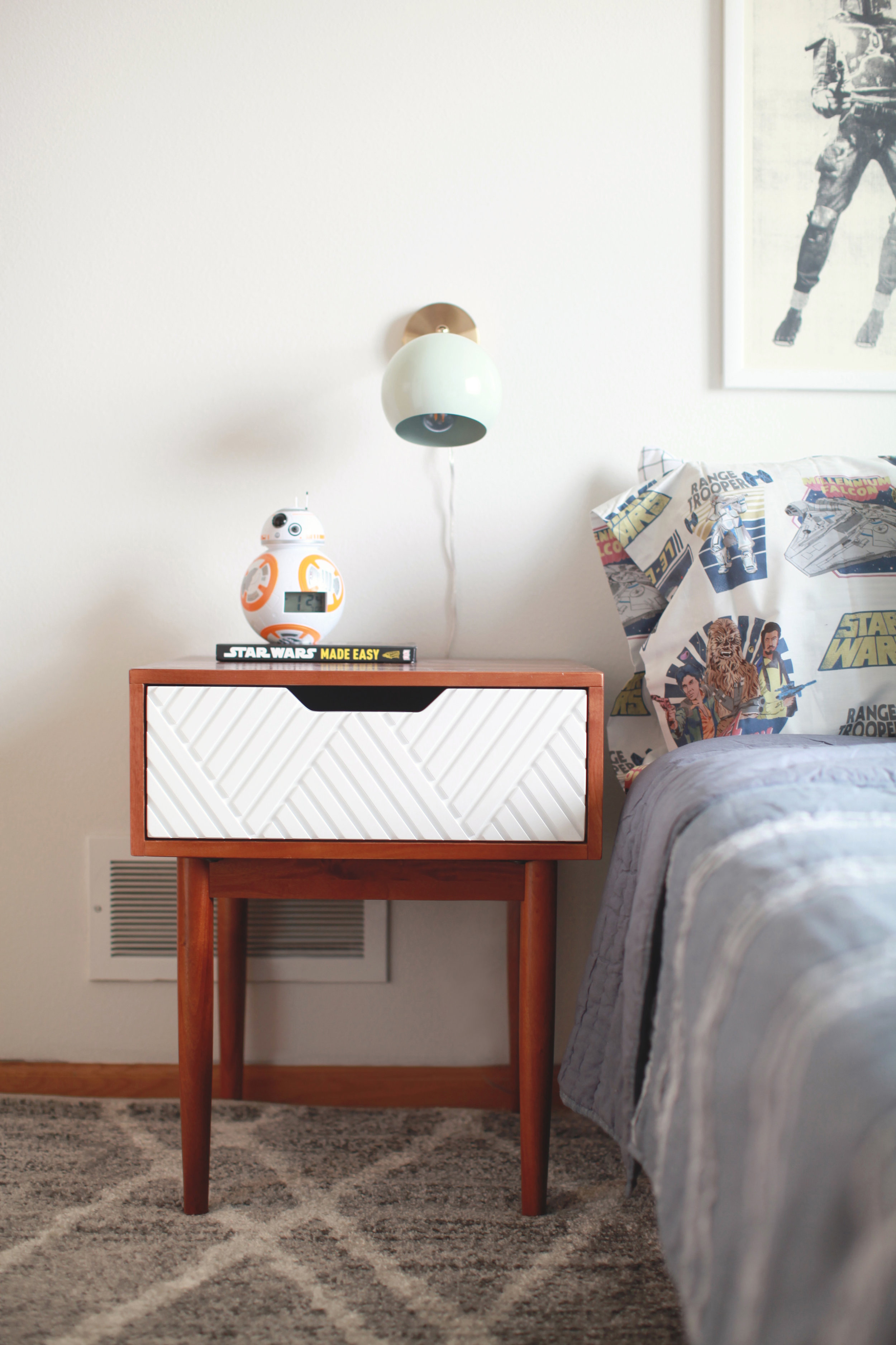 I love this  furniture set  - this is a nightstand and it matches the dresser on the other side of his room. I love the geometric lines in the white to tie in with the rest of the room and also the quality of this wood was much better than I expected so definitely recommend.