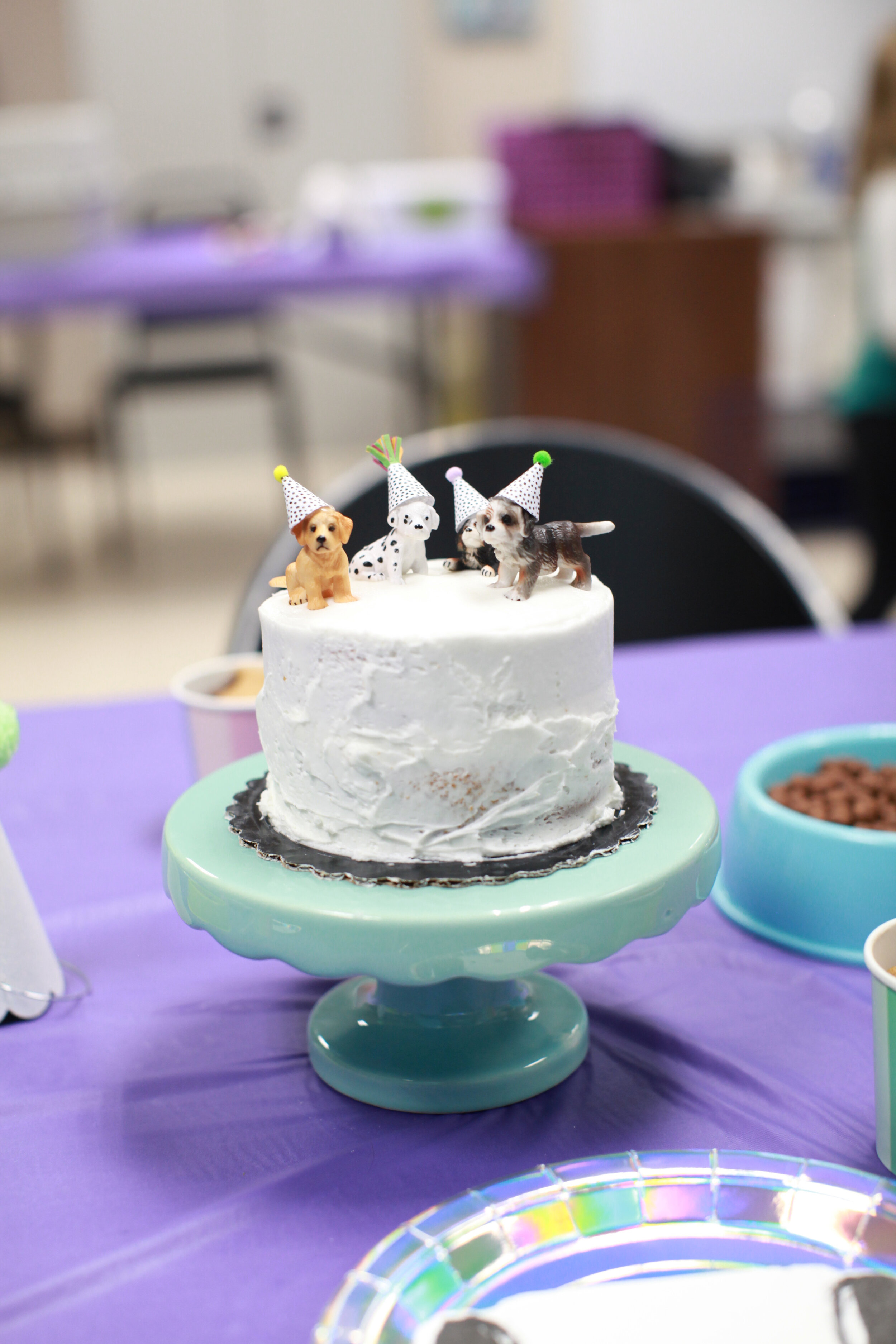 """I ordered the little puppies on Amazon and got their birthday hats from Etsy - ordered a plain cake from Hy-Vee and boom … easiest cake I have ever """"made"""" :)"""