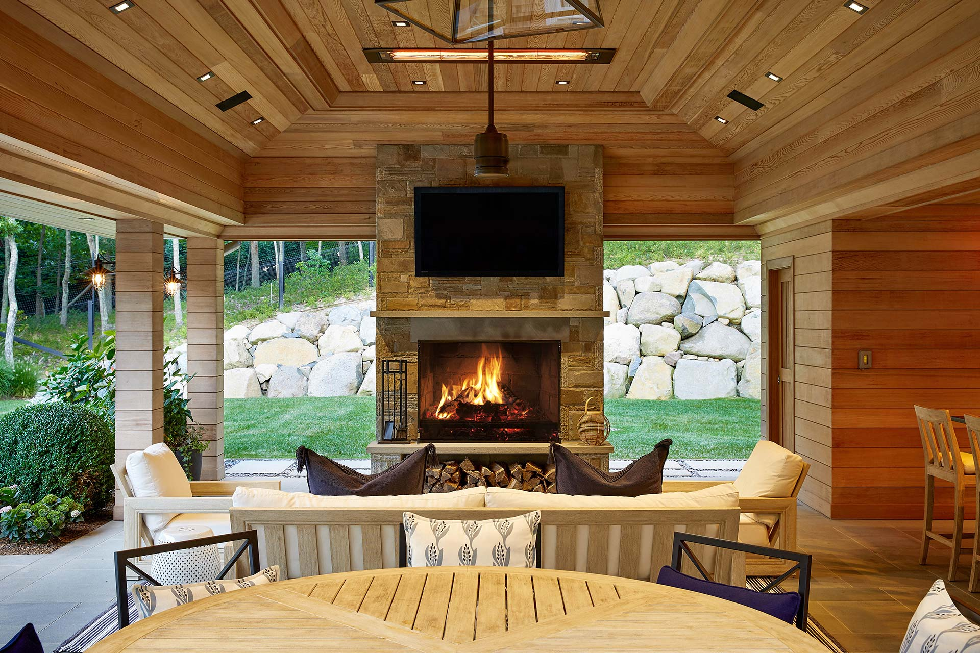 Outdoor fireplaces, both gas and woodburning, lend ambiance and warmth to a cool summer evening.