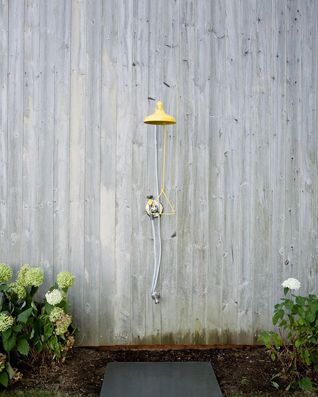 This 1880s weathered cedar barn was given a pop of color with this yellow shower head. We love the way it contrasts while bringing a summer feeling!