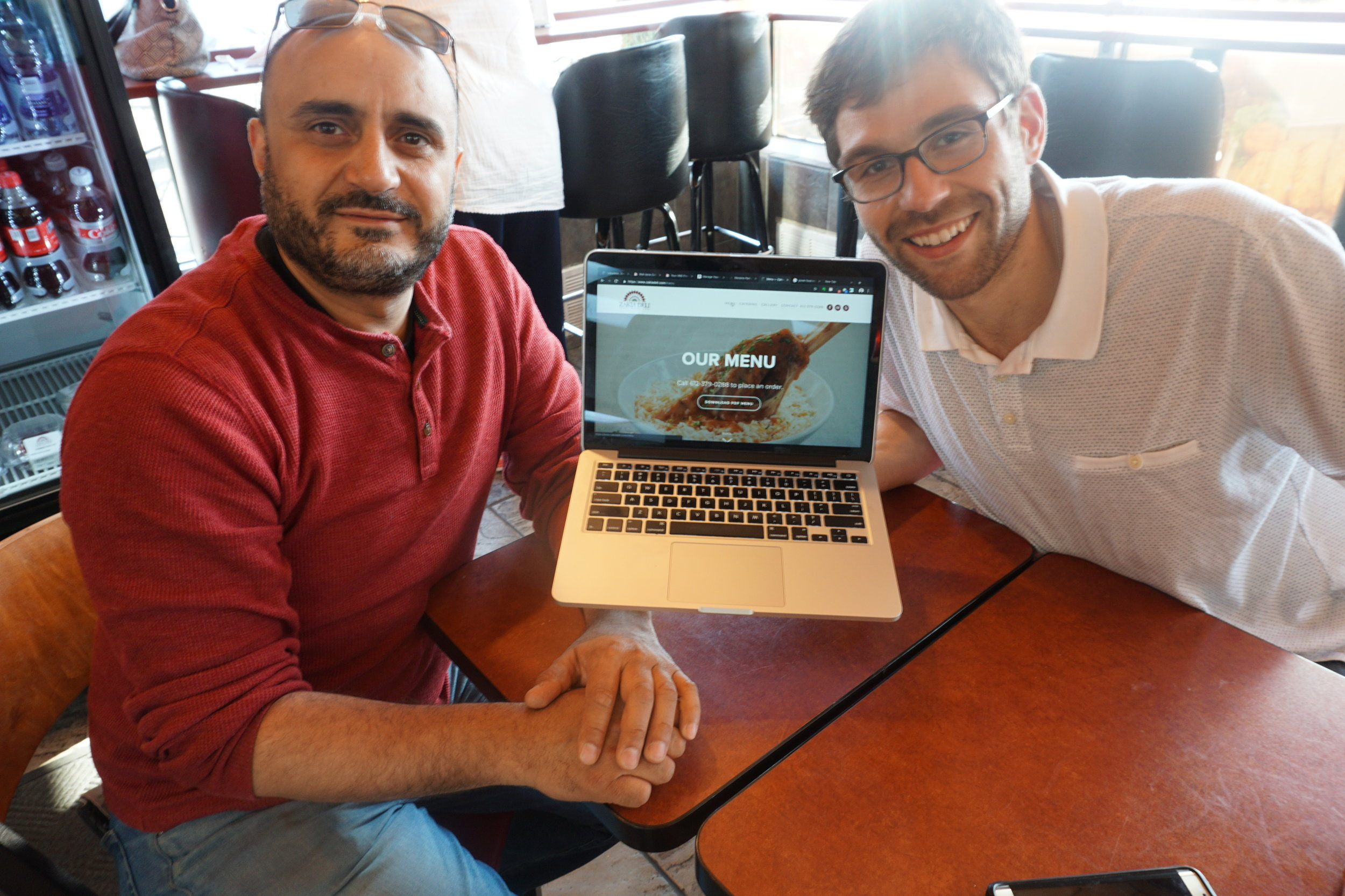 David and I working on the website together at Zakia Deli