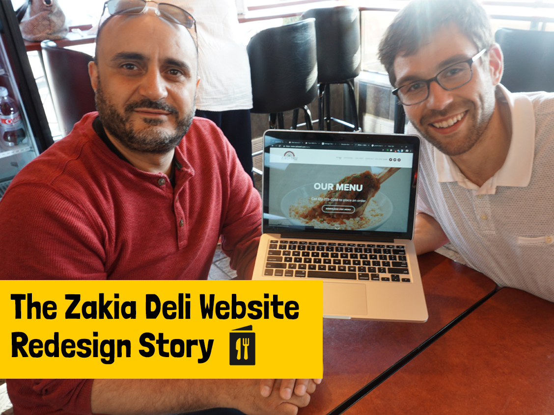 David and I sitting at Zakia Deli working on the website