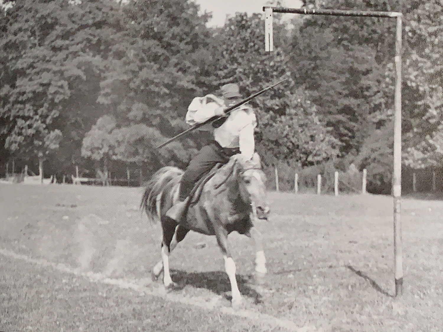 An unidentified rider is moving at full gallop, trying to win the 1952 ring spearing tournament tournament held during the tri-centennial celebration.