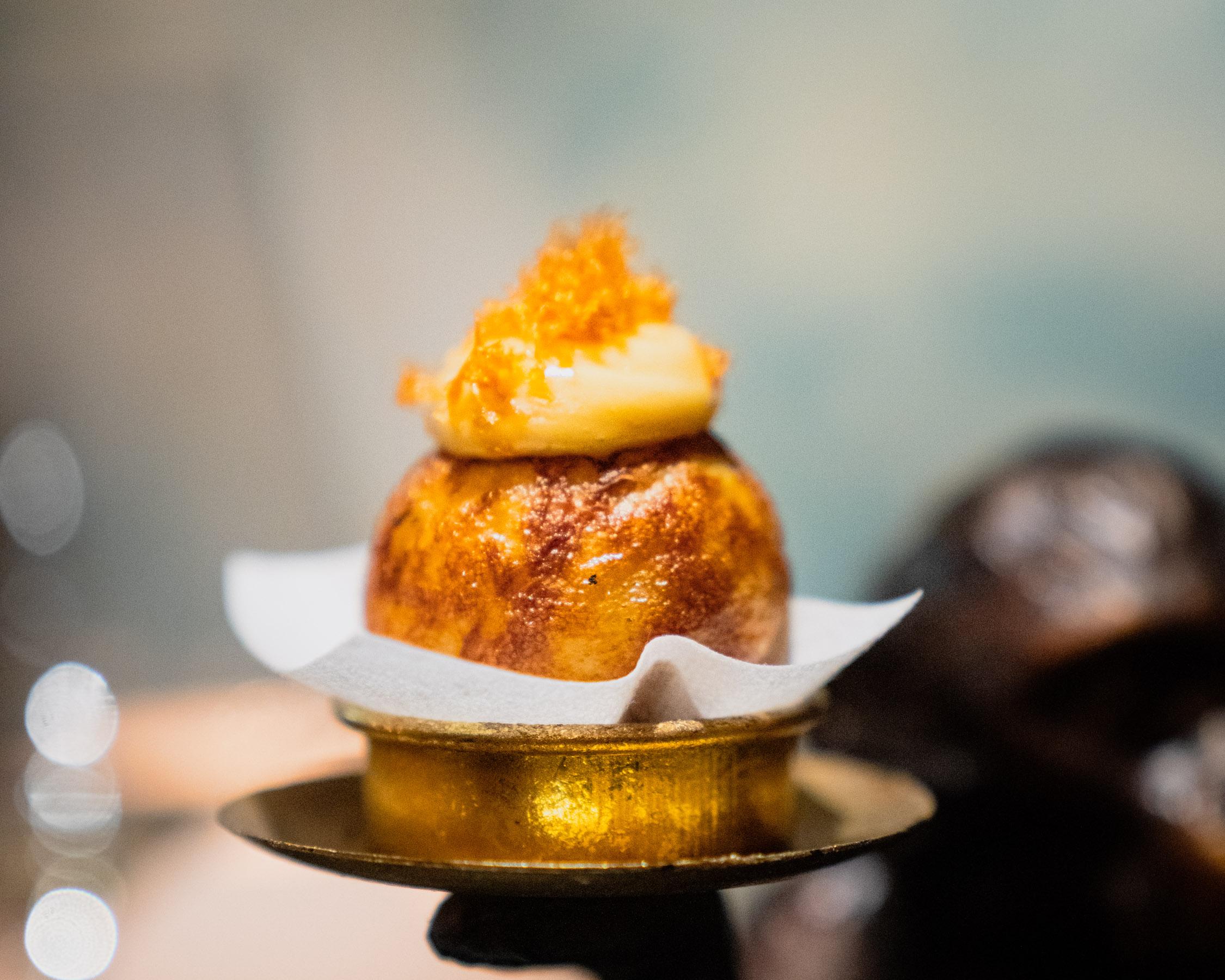 Æbleskiver with Buttered Dungeness Crab, Roasted Garlic & Pickled Jalapeño