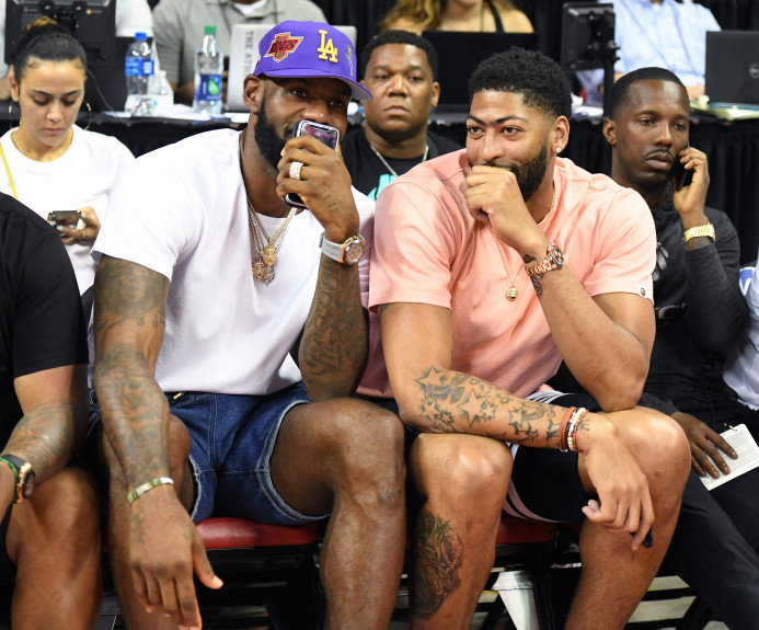 IMAGE: Ethan Miller / Getty Images - Left to Right: LeBron James, Anthony Davis, and agent Rich Paul watching a Summer League game between the New Orleans Pelicans and New York Knicks on Friday night July 5th.