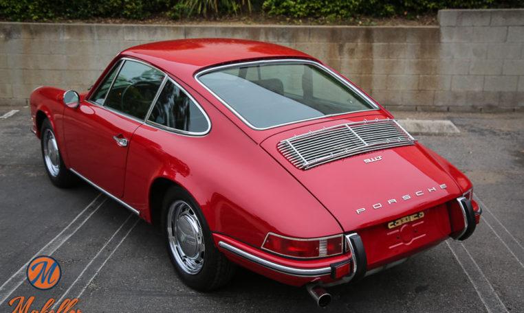 1969-porsche-911t-red-makellos-classics-driver-side-rear-angle-view.jpeg