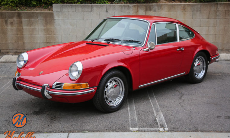 1969-porsche-911t-red-makellos-classics-driver-side-view.jpeg