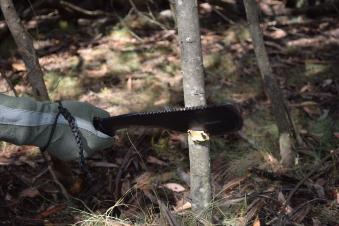 The Heiman Hatchet has a curved spine like a kukri. The front edge of the Heiman Hatchet comprises concave and convex edges which can be used as an axe, machete and a knife.    Buy Now