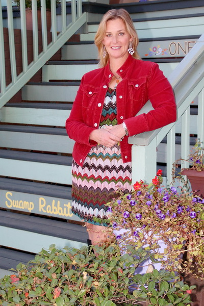 Wendy Lynam in front of the first Swamp Rabbit Inn in Greenville, SC