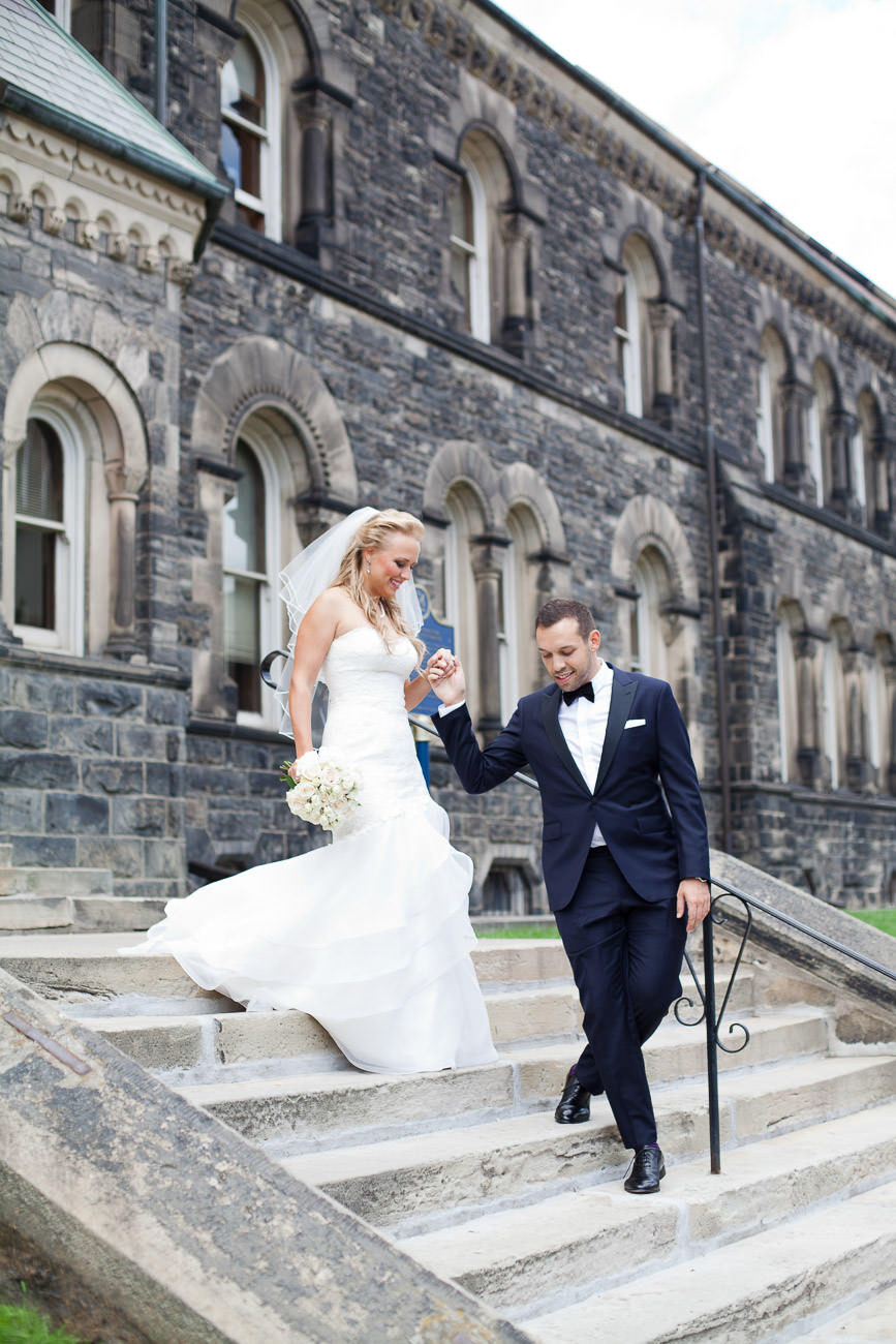 Bride and groom walking downstairs of a castle house green orchard wedding