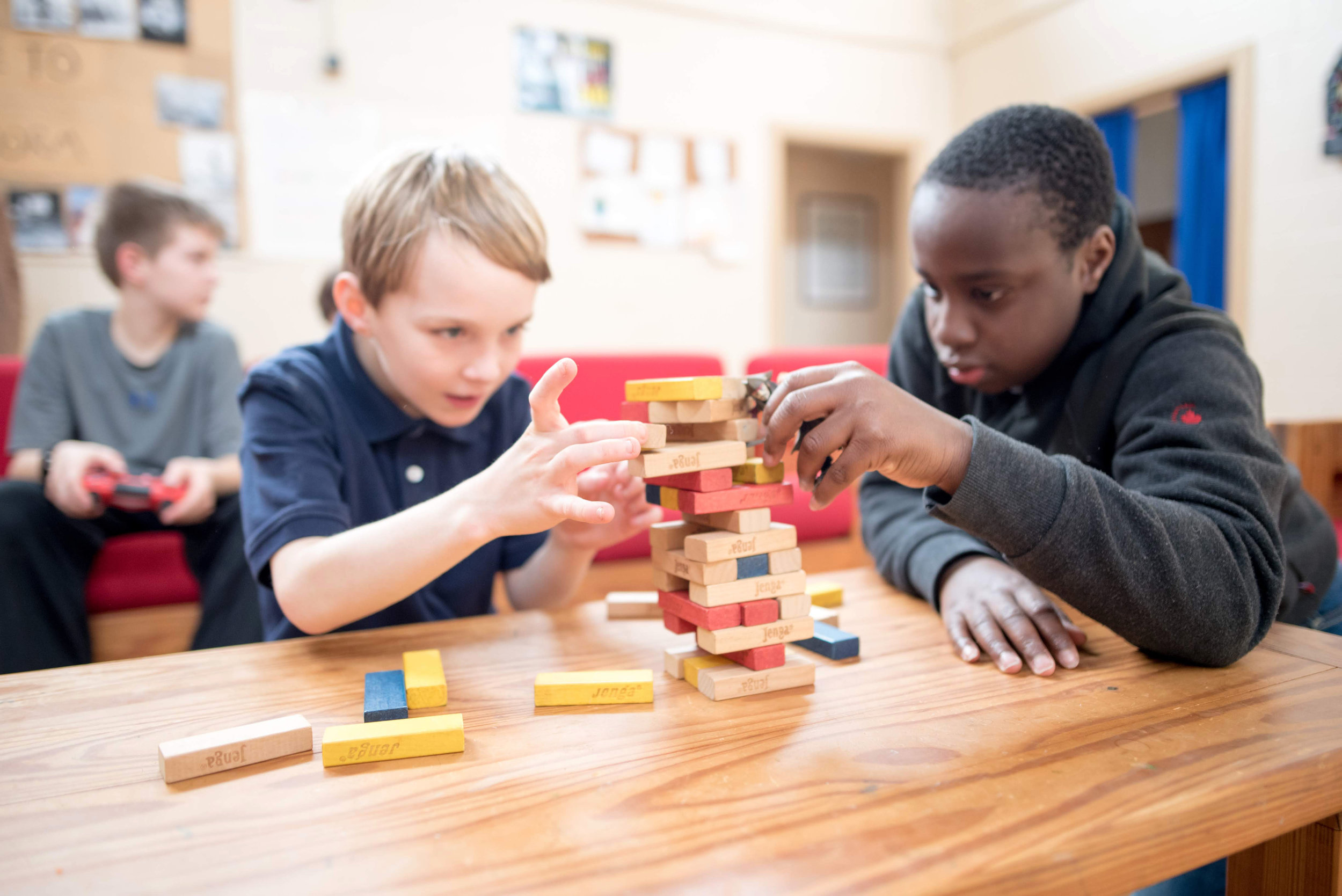 Two Oakland students focus on a game of Jenga.