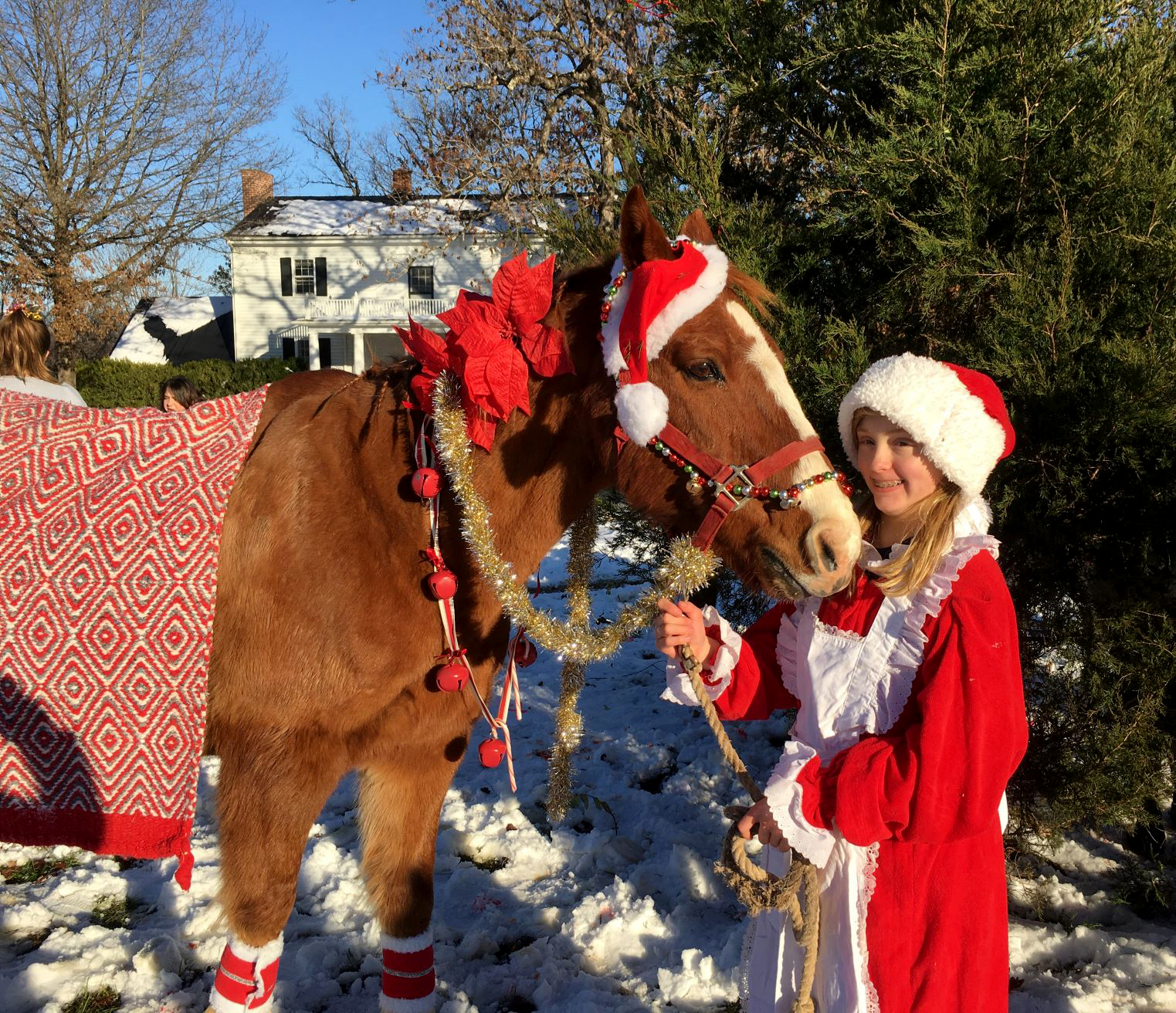 An Oakland School student and her horse companion are ready for Horse Holiday.