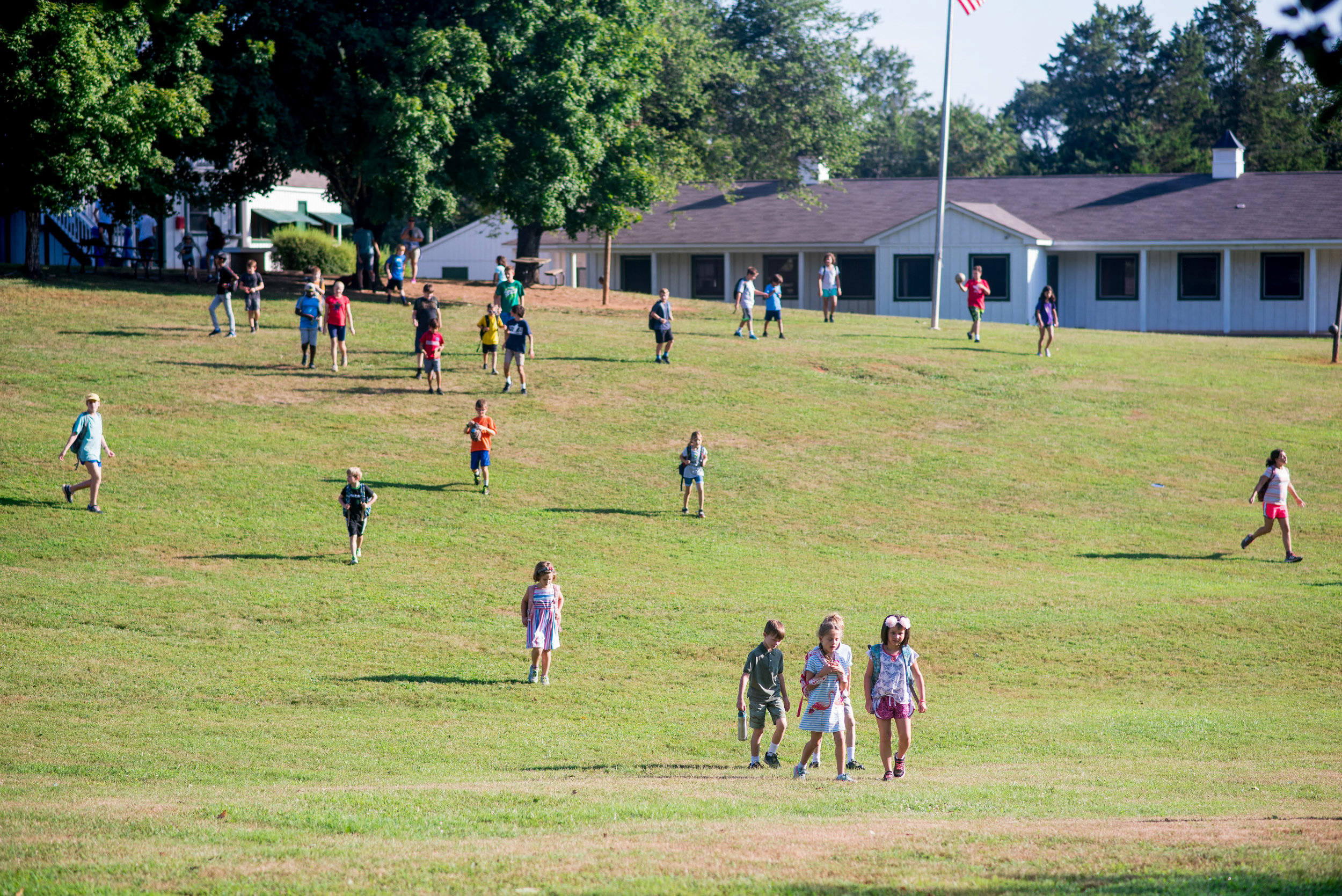 Oakland School students walk across part of the 450-acre campus.