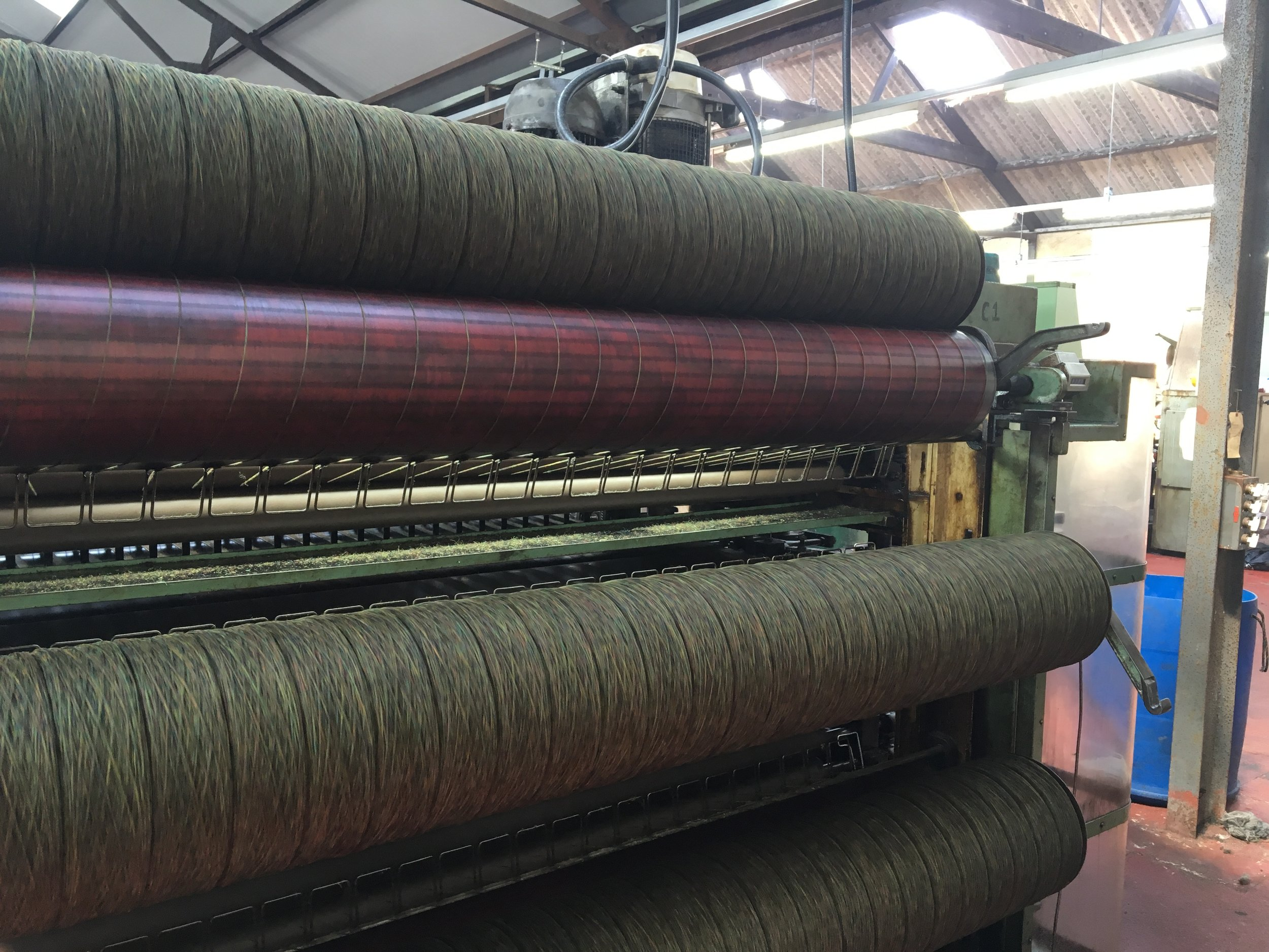 A machine at Kenneth Mackenzie on the Isle of Lewis in Scotland, depicting part of the process used to turn the wool fibers into fabric that will last a lifetime
