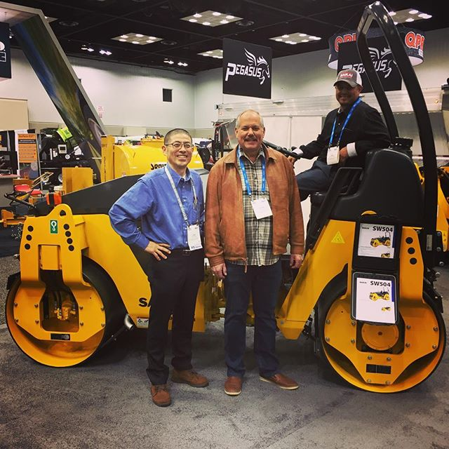 Dad and Saul modeling this year's haul... our first SAKAI! Looking forward to seeing this guy in action 👍🏻👍🏻 #SW504 #sakai #asphaltpaving #asphalt #worldofasphalt2019 #familybusiness