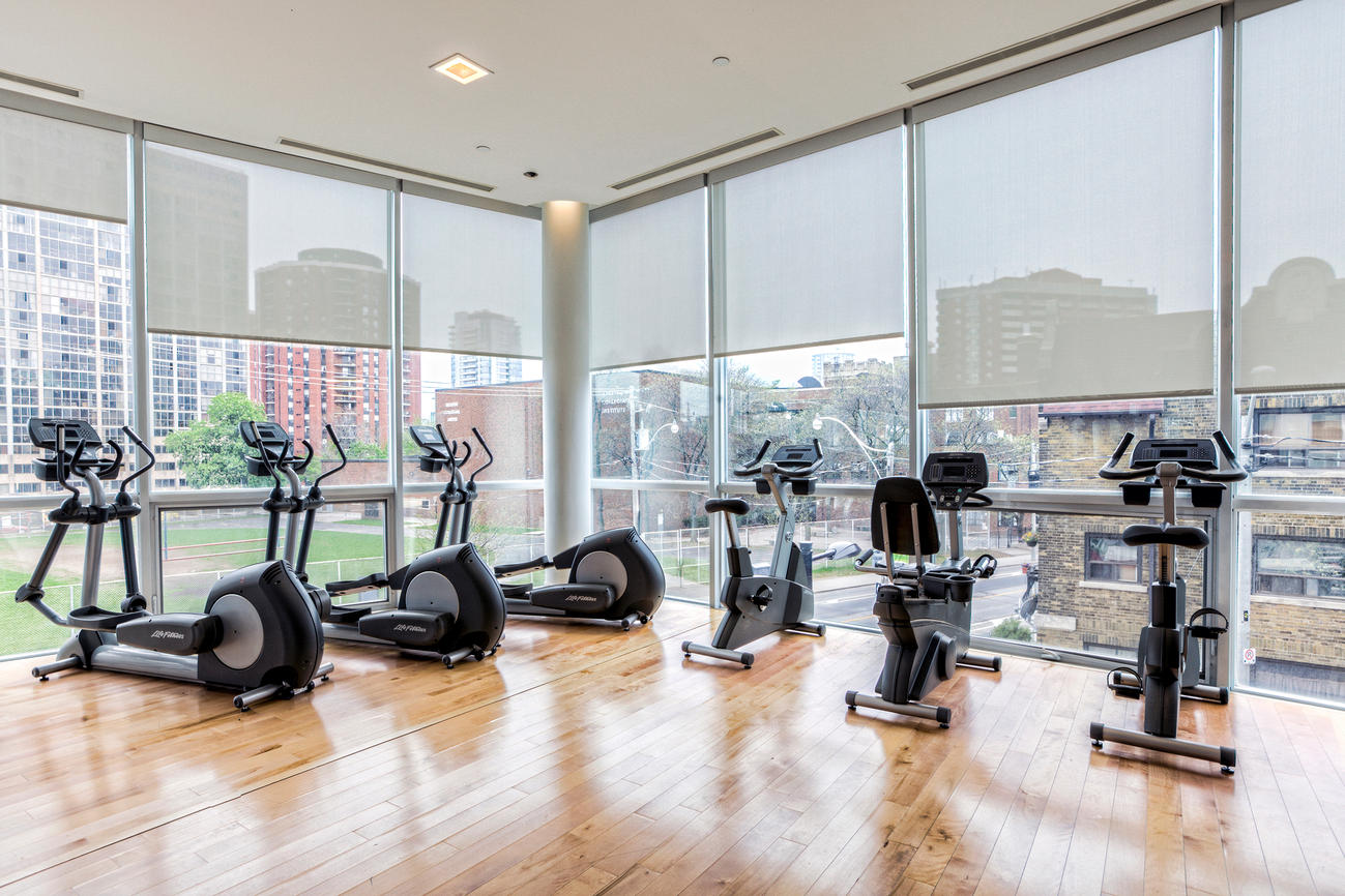 condo-gym-hardwood-floor-natural-light-1147166.jpg