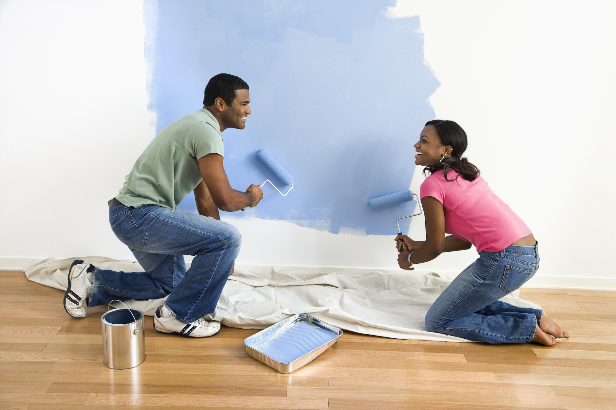 Couple painting their walls blue