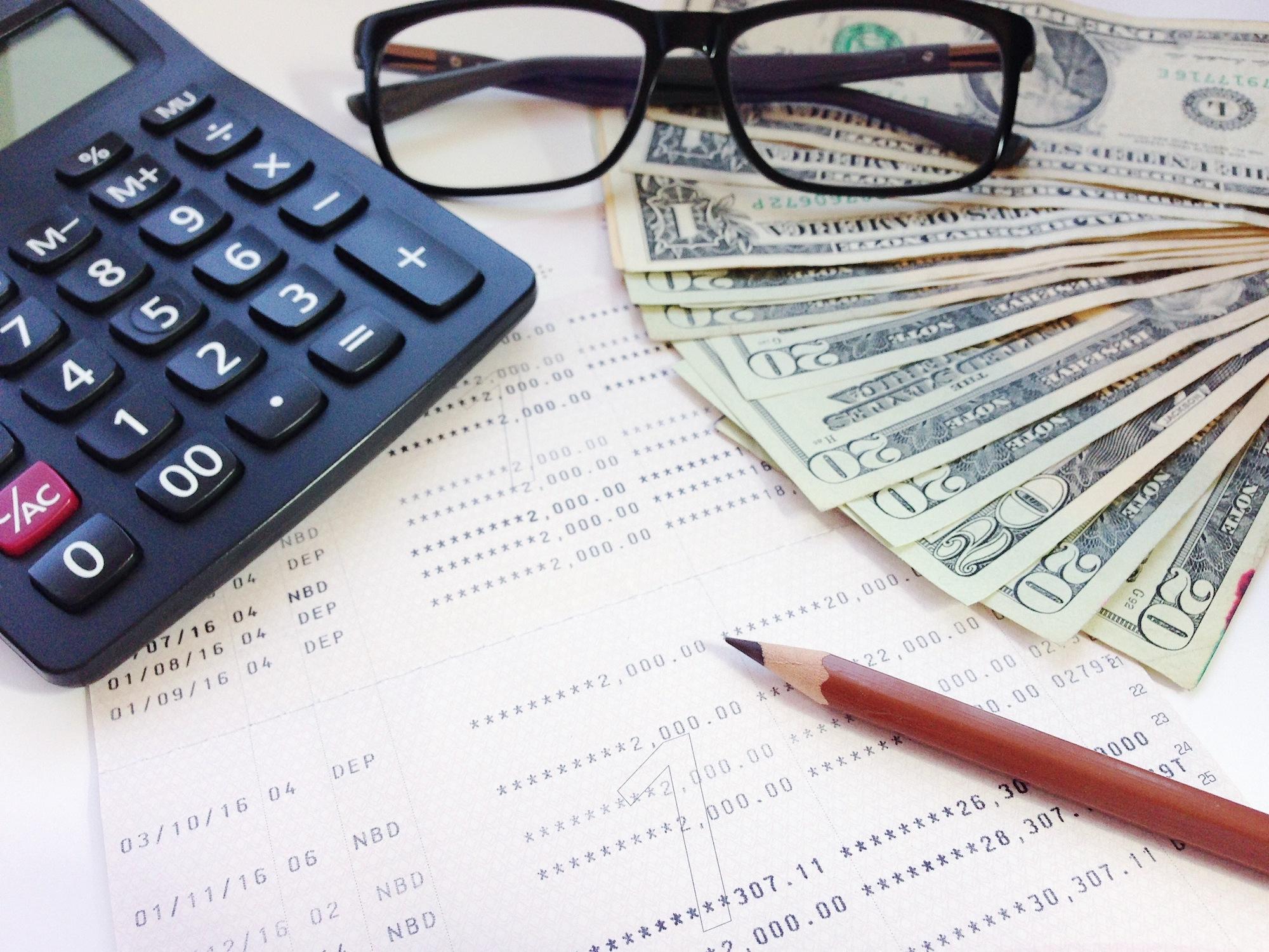 Money, glasses, and calculator
