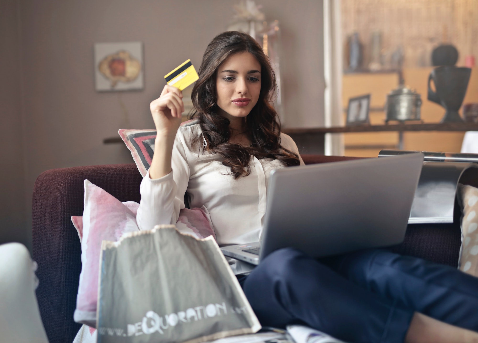 Woman buying something online with her credit card