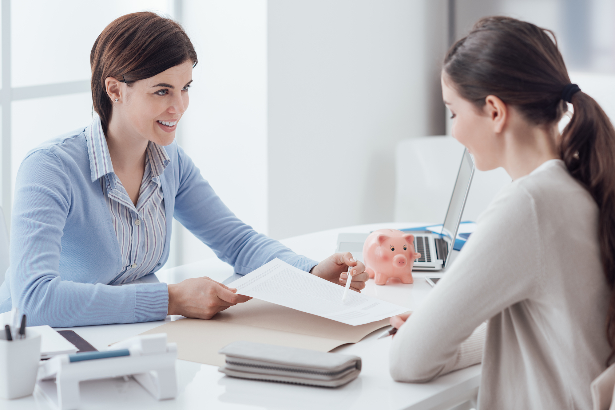 Banker consulting their client about a loan