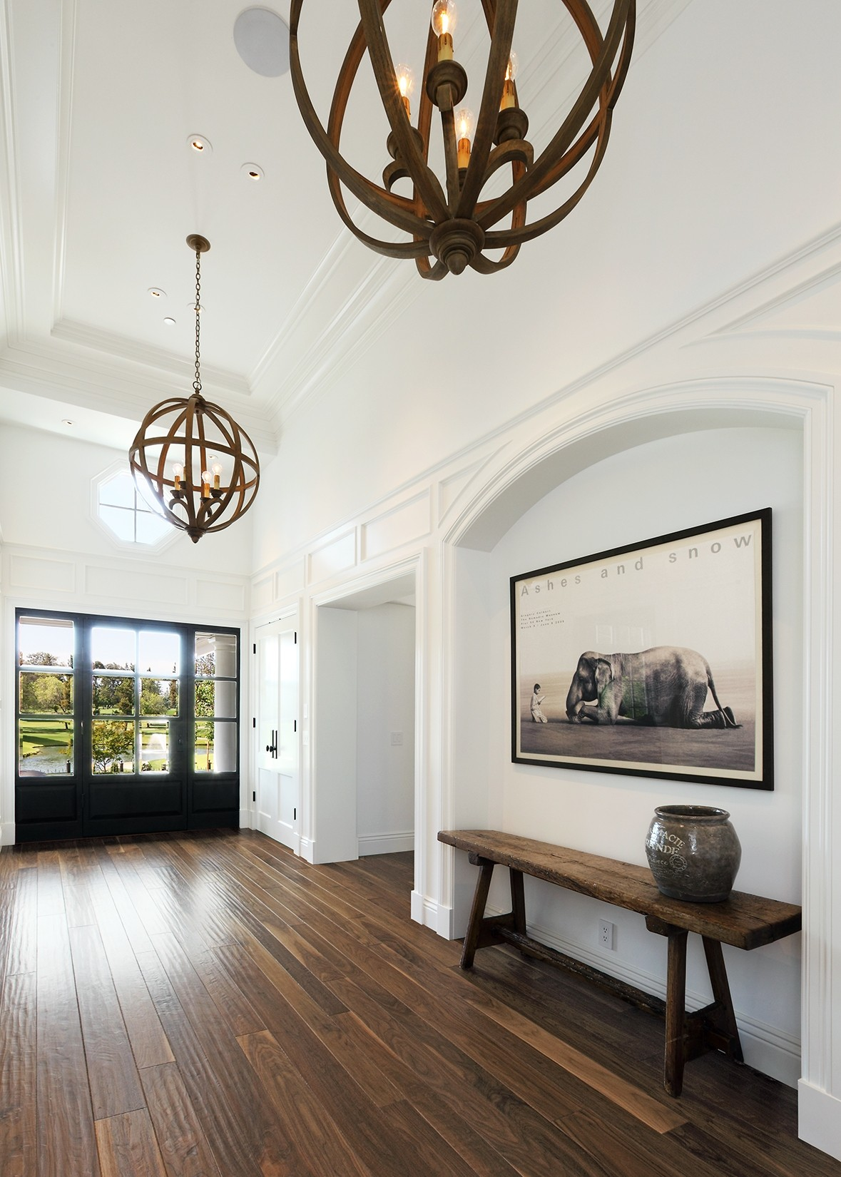 golf_house_entryway_foyer_globe_chandelier_modern.jpg