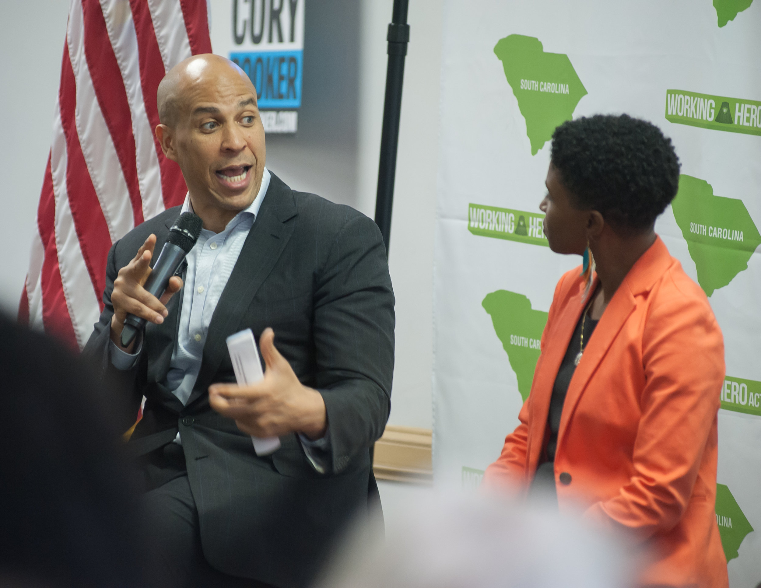 Senator Cory Booker speaks with Working Hero South Carolina director Rania Jamison at a community forum on economic inequality.
