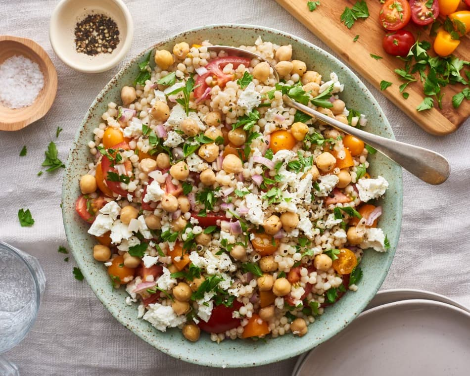 Israeli Couscous Salad with Feta, Chickpeas, and Herbs    via The Kitchn.