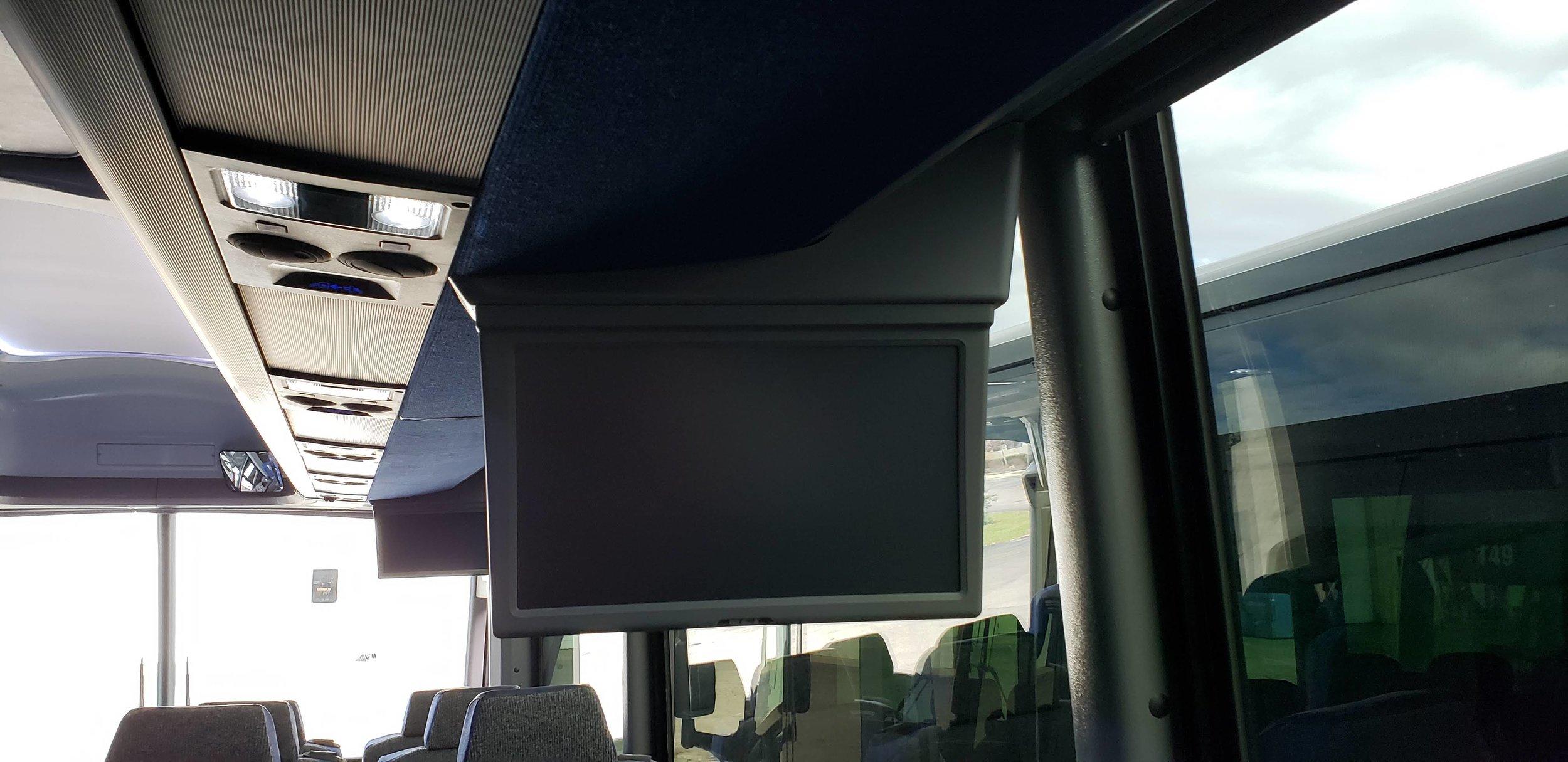 Motorcoach Passenger Flat Screens Reading Lights and Air Vents.jpg