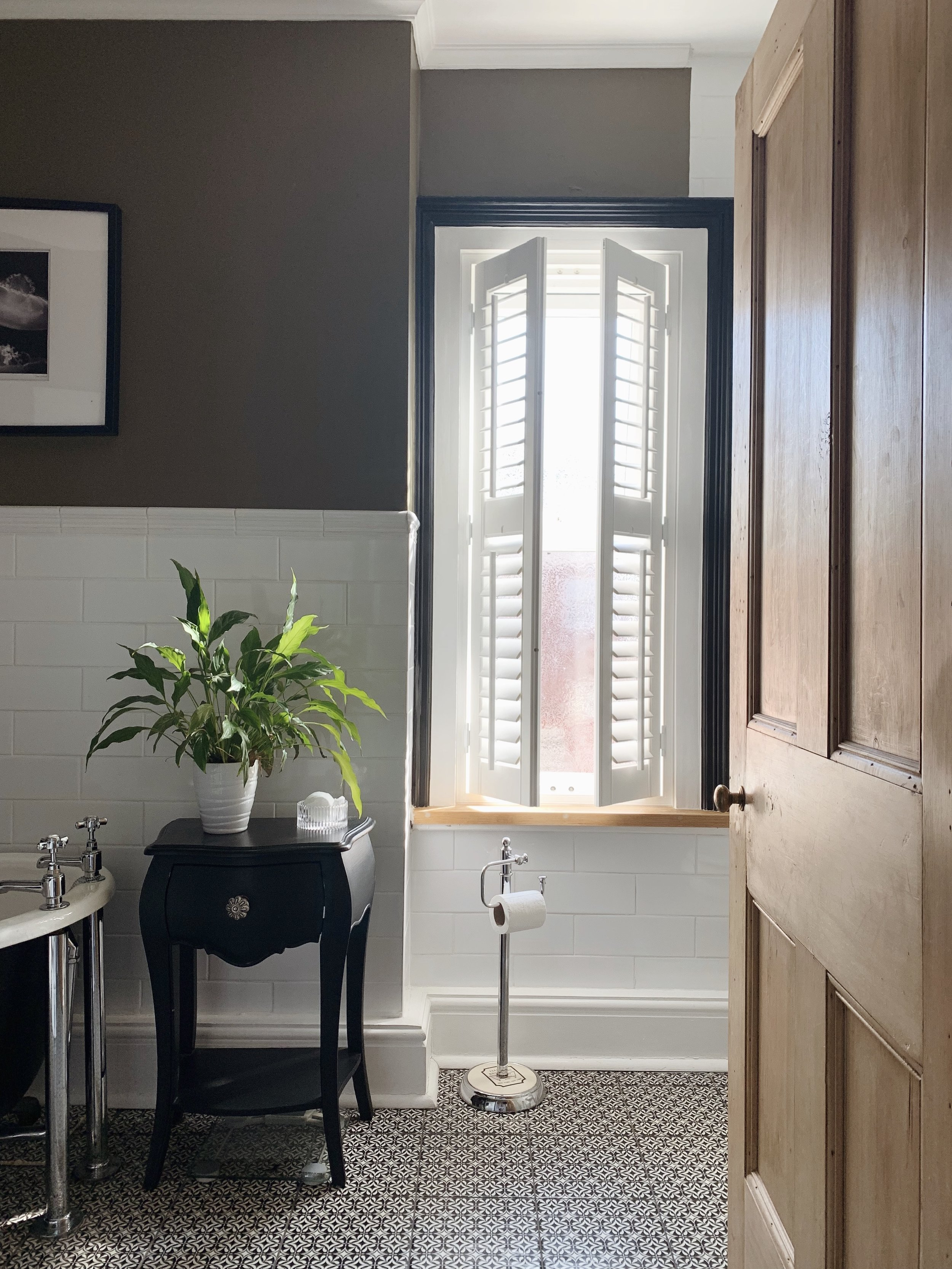 Image from our bathroom with 247 Blinds  Left and right opening of a 2 panel, full height shutter with mid rail and standard tilt rods.