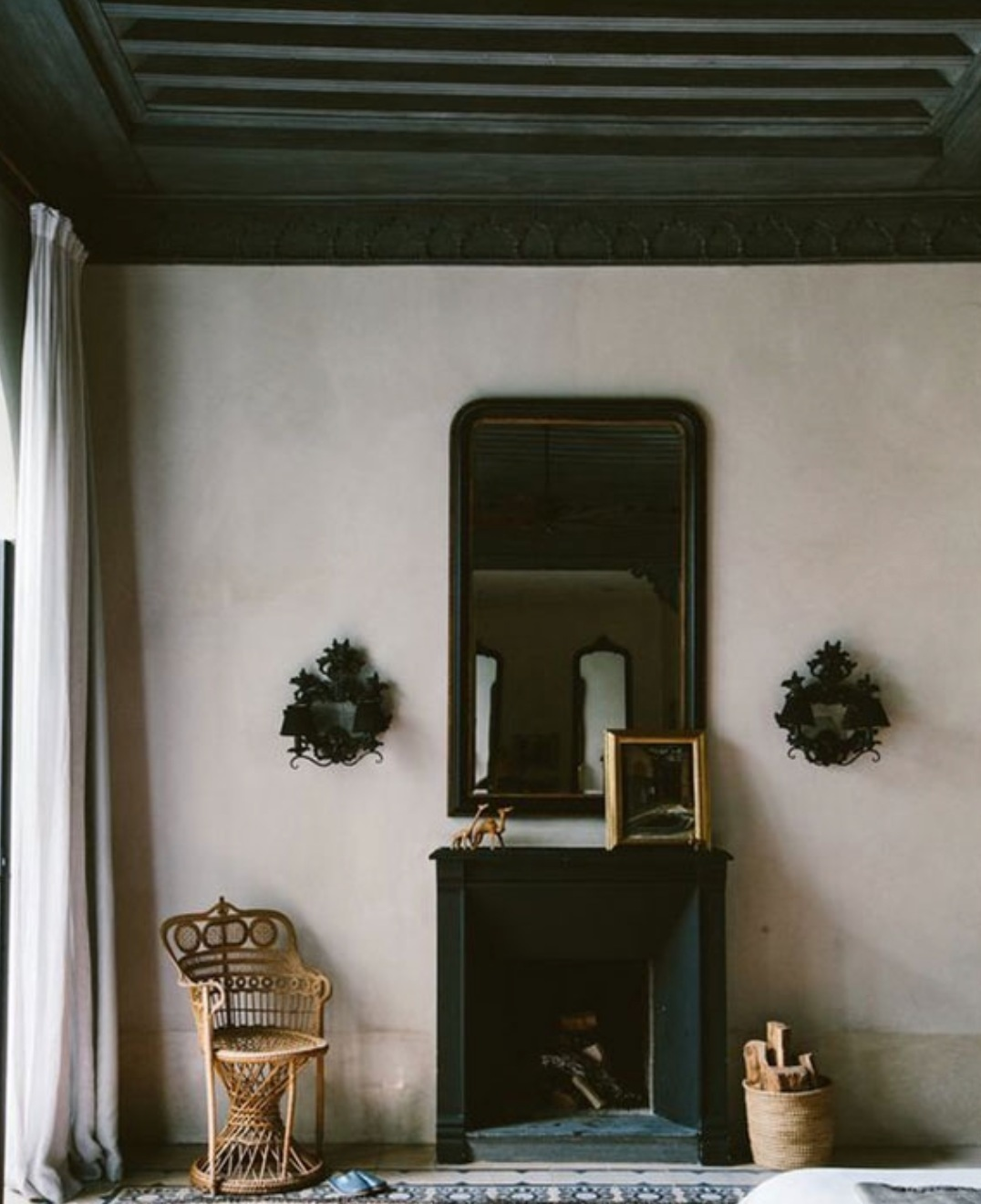 The neutral tones and dark, detailed ceiling in this image from  Semikah Textiles  are  everything