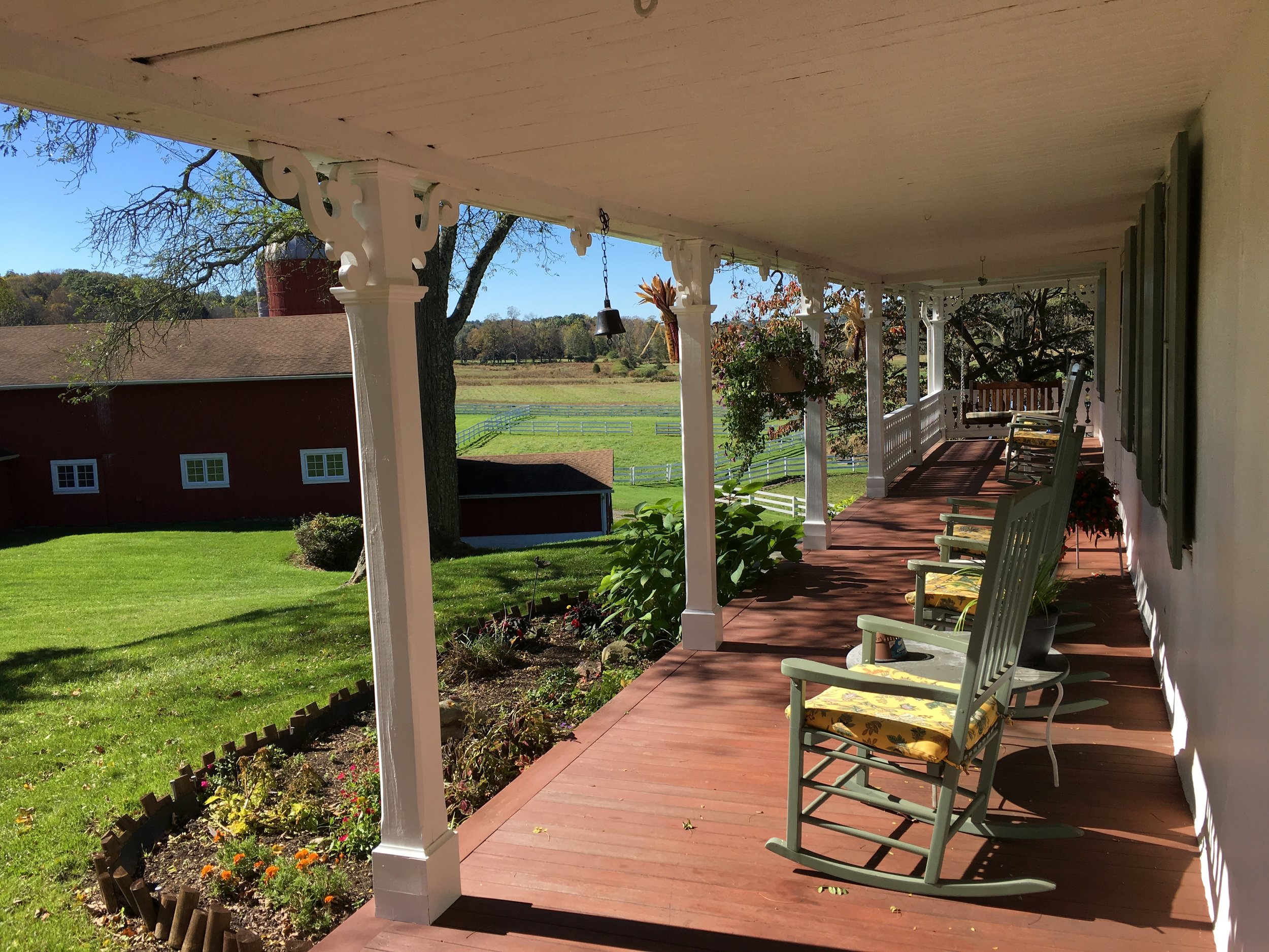 Front porch of the house overlooking the property